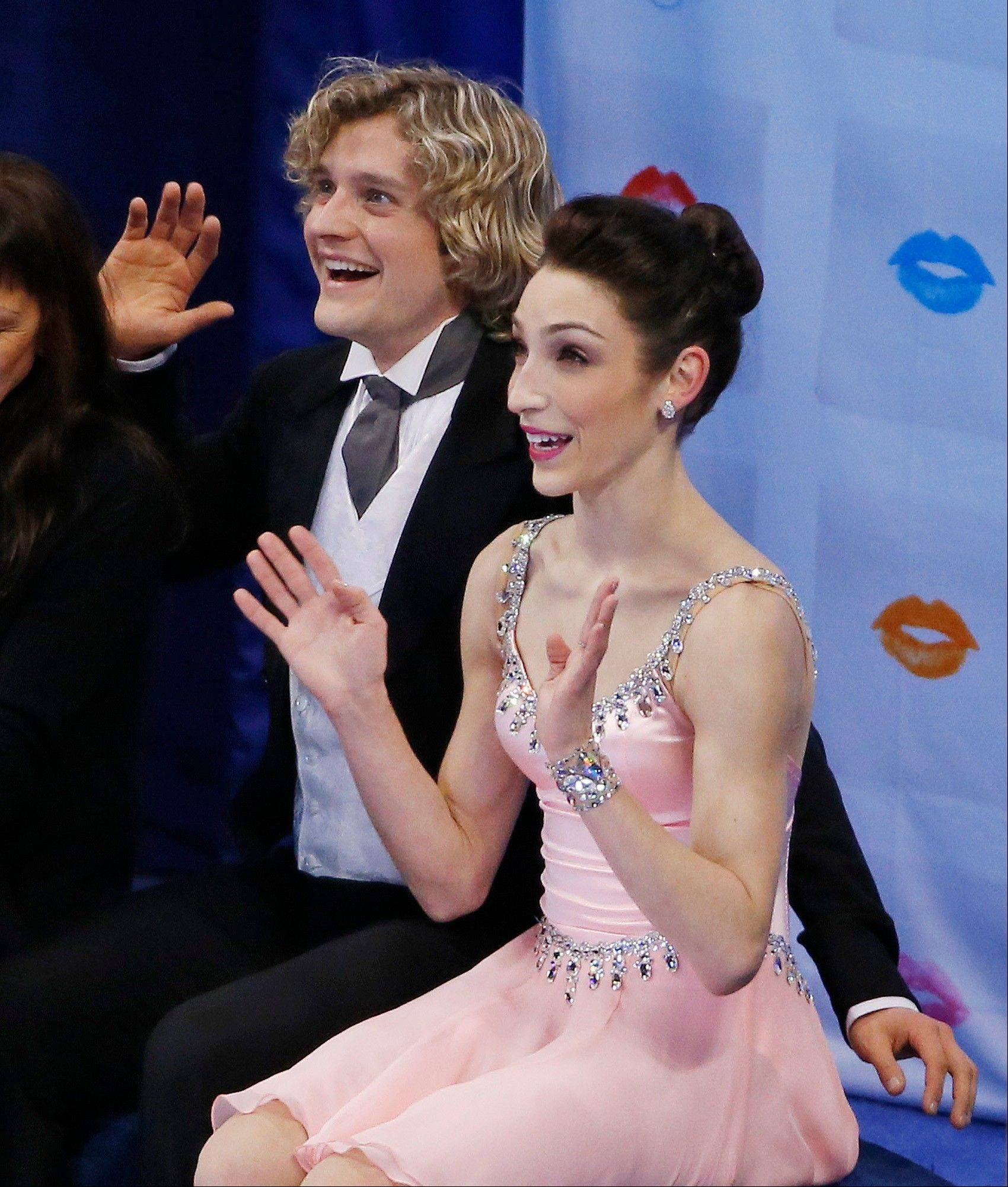 Ice dancers Meryl Davis and Charlie White react as the scores are posted Friday for their short program at the U.S. Figure Skating Championships in Boston.