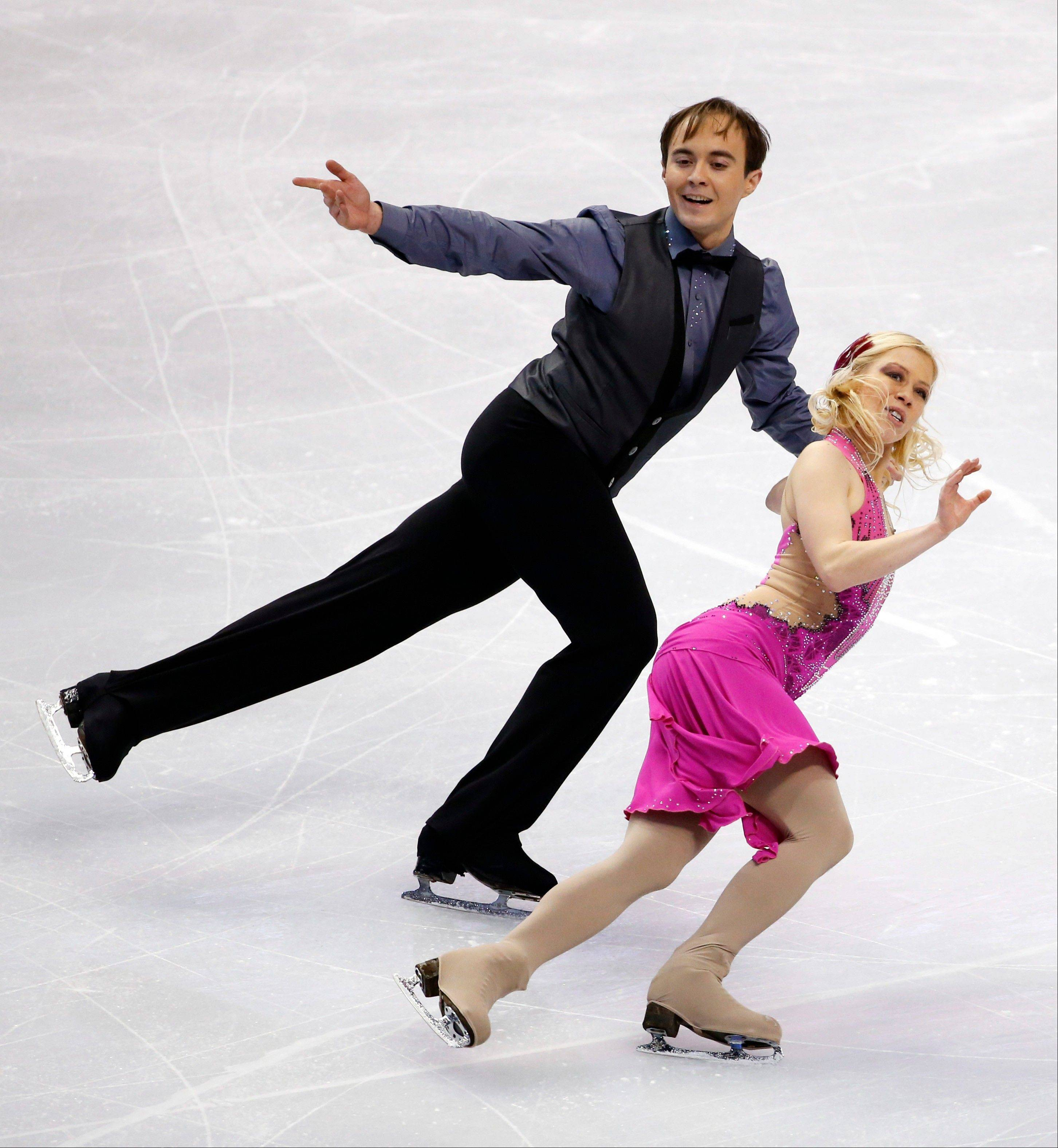 Kseniya Ponomaryova and Oleg Altukhov, who both train in Naperville, skate during the ice dance short program Friday at the U.S. Figure Skating Championships in Boston. They ended the short program in 16th place.