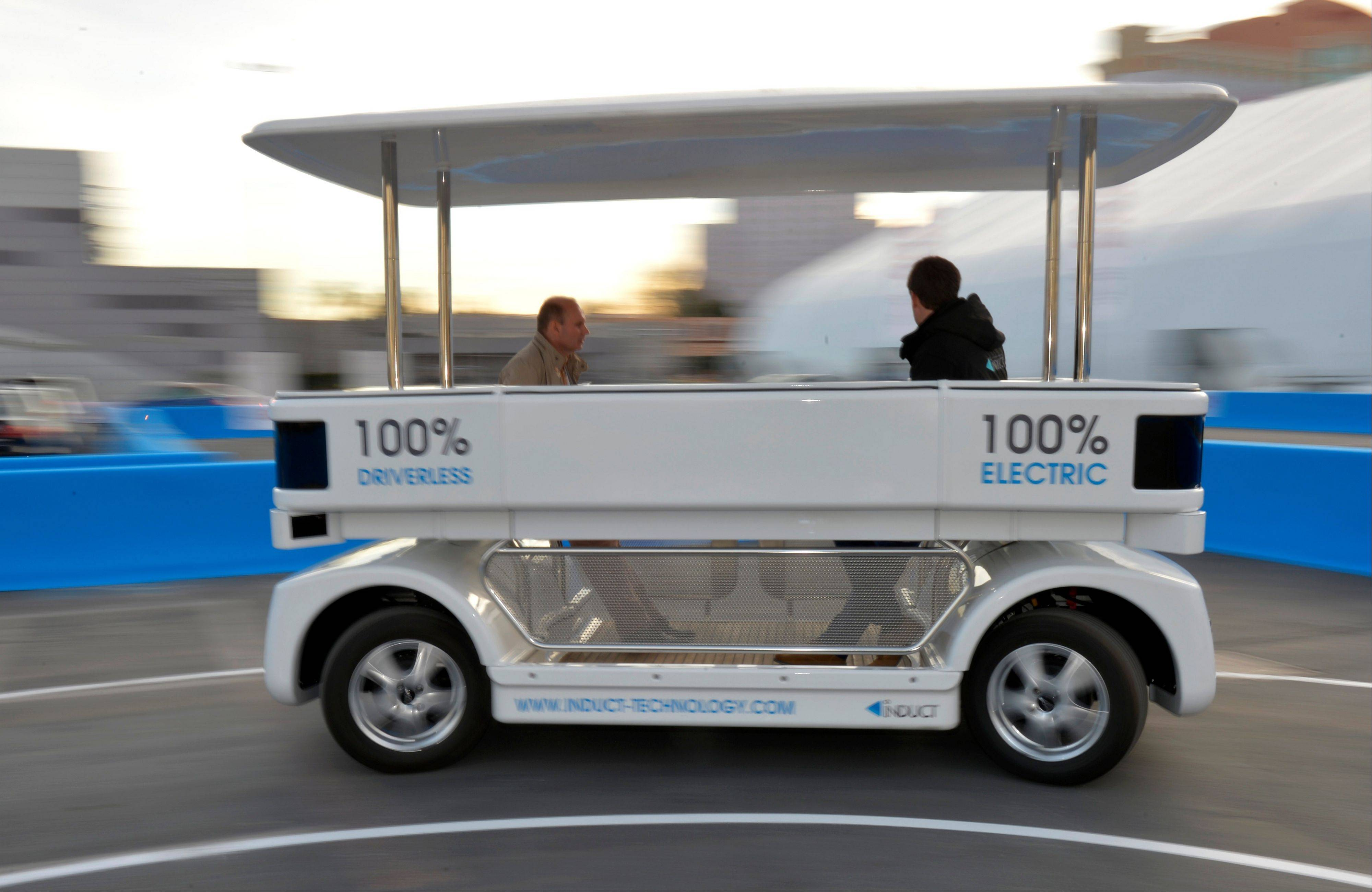 Induct demonstrates their new Navia driverless shuttle at the International Consumer Electronics Show in Las Vegas.