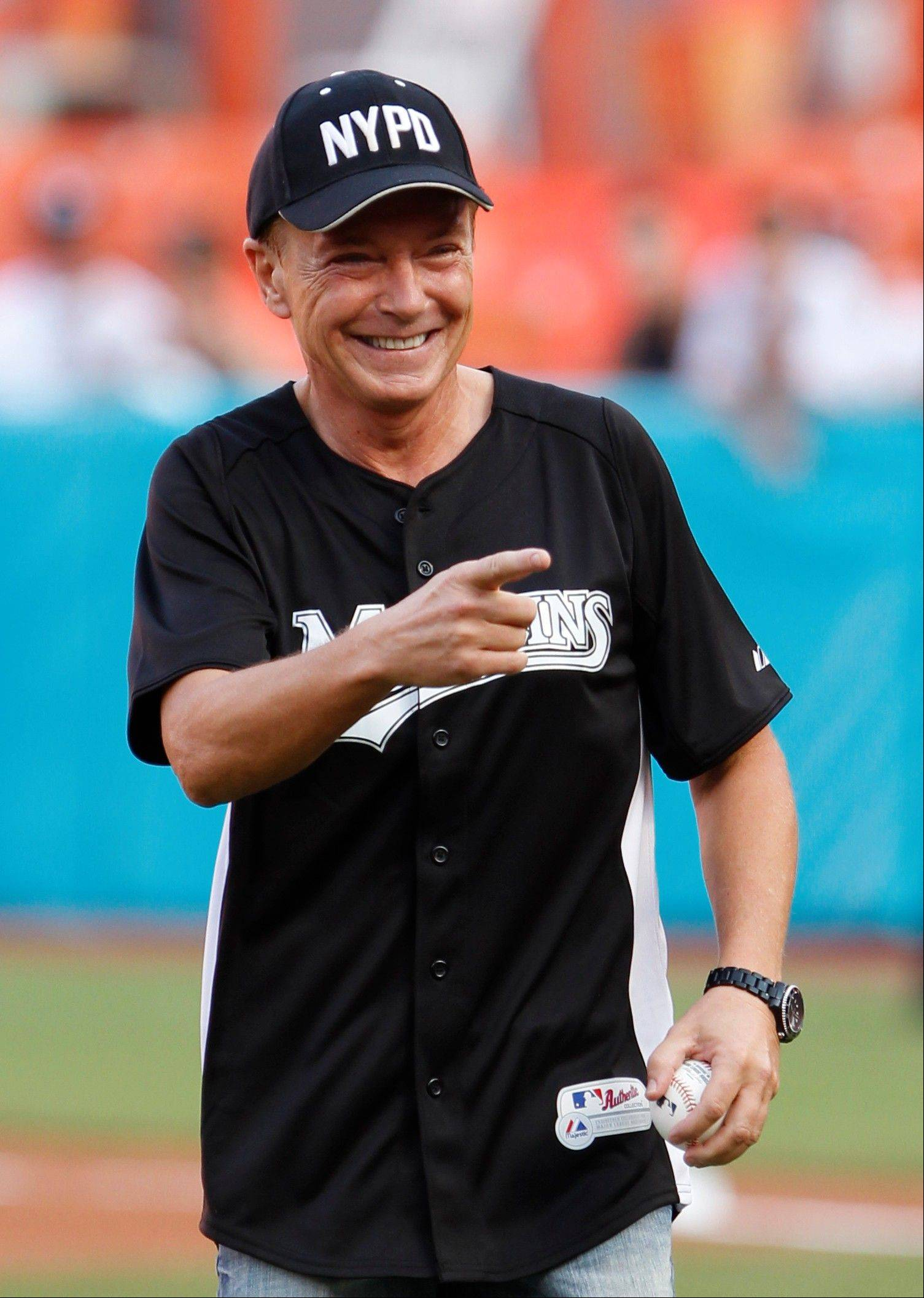 This July 9, 2011, file photo shows actor David Cassidy after throwing out a ceremonial first pitch before a baseball game between the Florida Marlins and the Houston Astros, in Miami. Cassidy was arrested Friday in Southern California on suspicion of drunken driving.