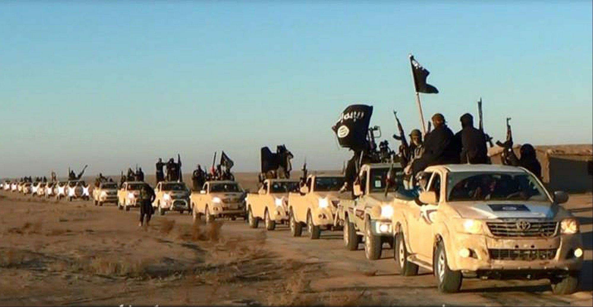 This image posted on a militant website on Jan. 7 shows a convoy of vehicles and fighters from the al-Qaida linked Islamic State of Iraq and the Levant (ISIL) fighters in Iraq's Anbar Province.