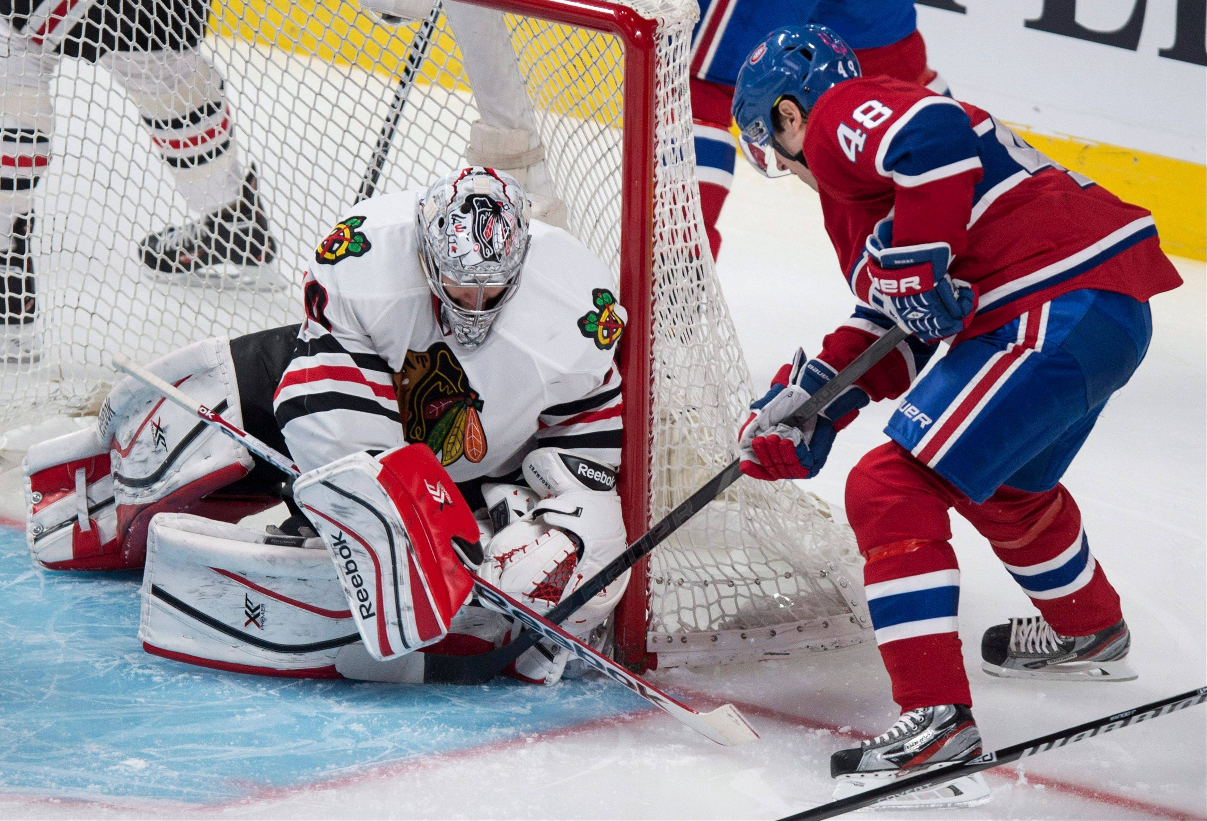 Chicago Blackhawks goalie Corey Crawford stops Montreal Canadiens� Daniel Briere during the second period Saturday in Montreal. The Blackhawks lost 2-1 in overtime.