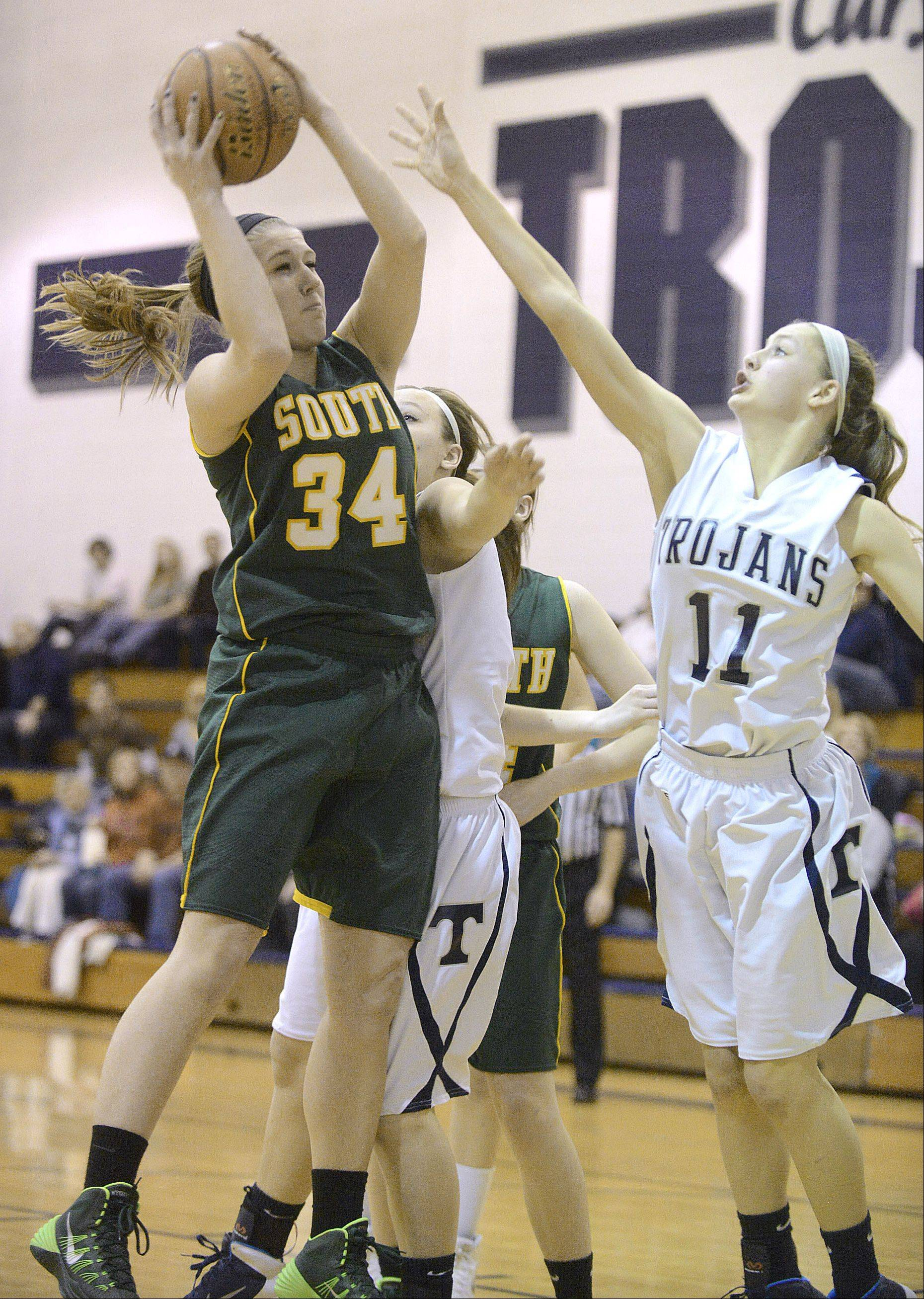 Crystal Lake South�s Sara Mickow (34) grabs a rebound before Cary-Grove�s Candace Cunningham can reach the ball in the third quarter on Saturday in Cary.