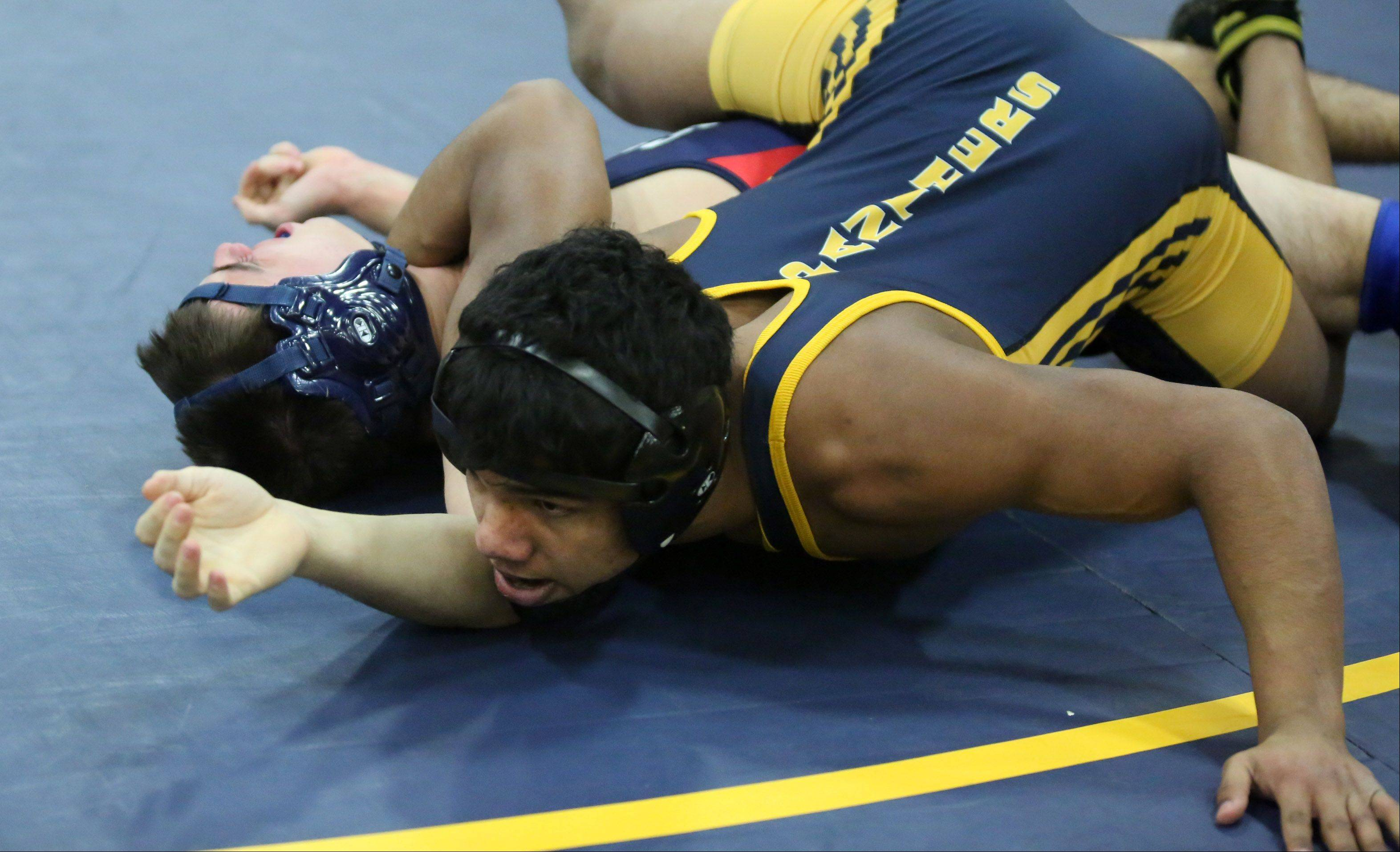 Round Lake�s Nick Moore, right, pins St. Viator�s Jack Debartolo in their 152-pound match at Round Lake on Saturday.