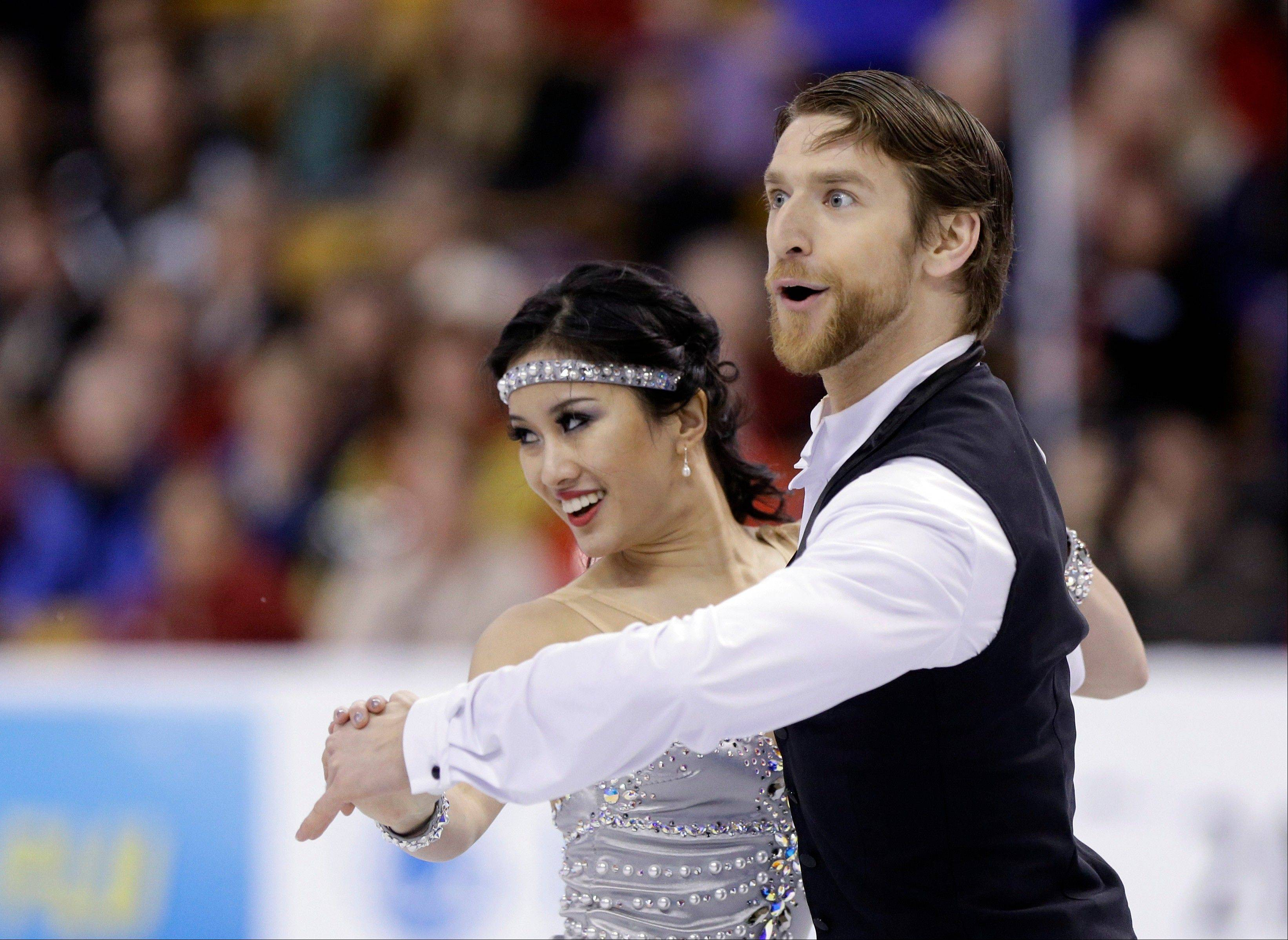 Lynn Kriengkrairut and Logan Giulietti-Schmitt skate during the ice dance short program at the U.S. Figure Skating Championships Friday, Jan. 10, 2014 in Boston. (AP Photo/Steven Senne)