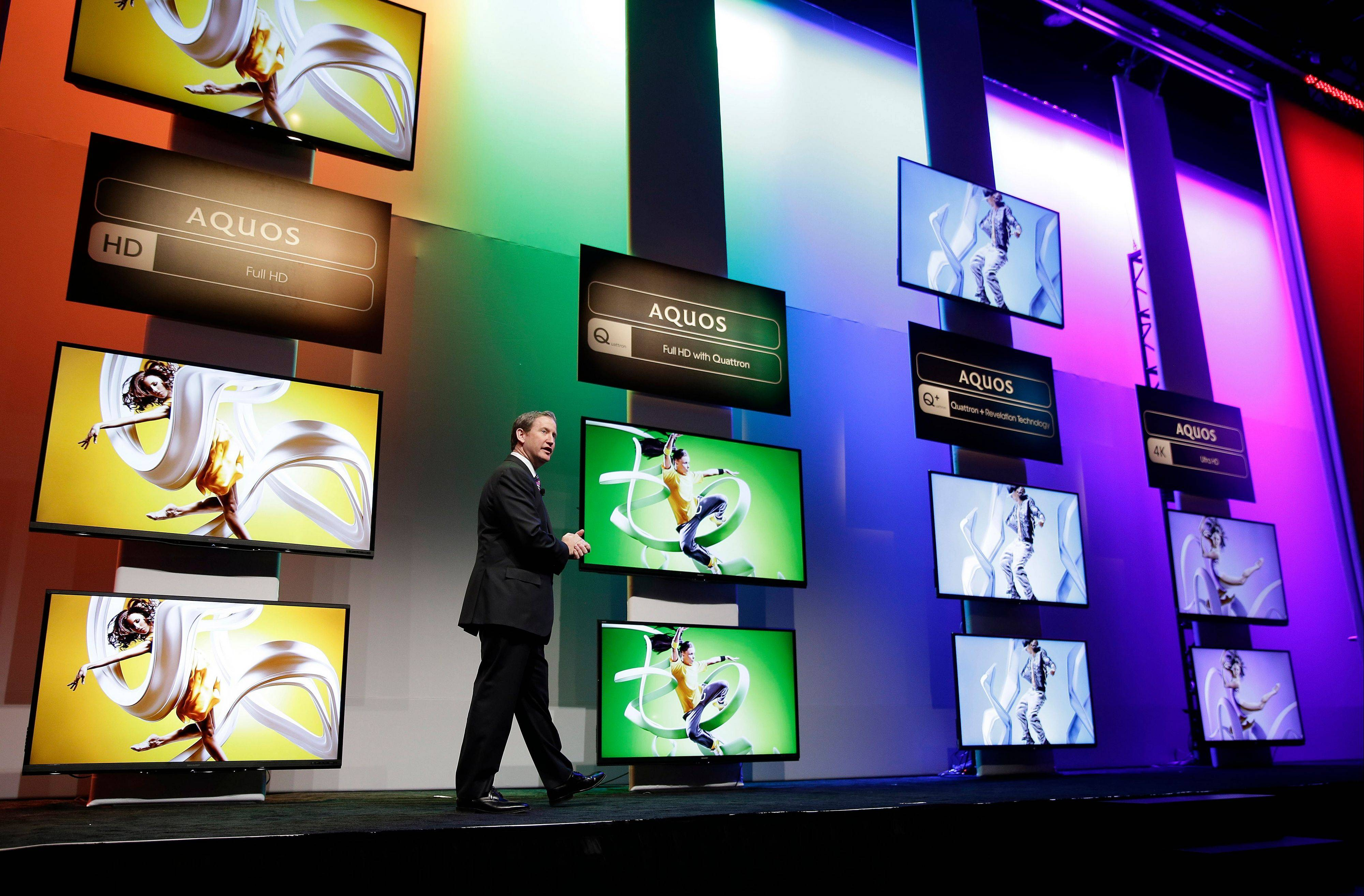 President of Sharp Electronics Marketing Corporation of America John Herrington speaks during a news conference announcing the new lineup of Sharp televisions at the Consumer Electronics Show in Las Vegas.