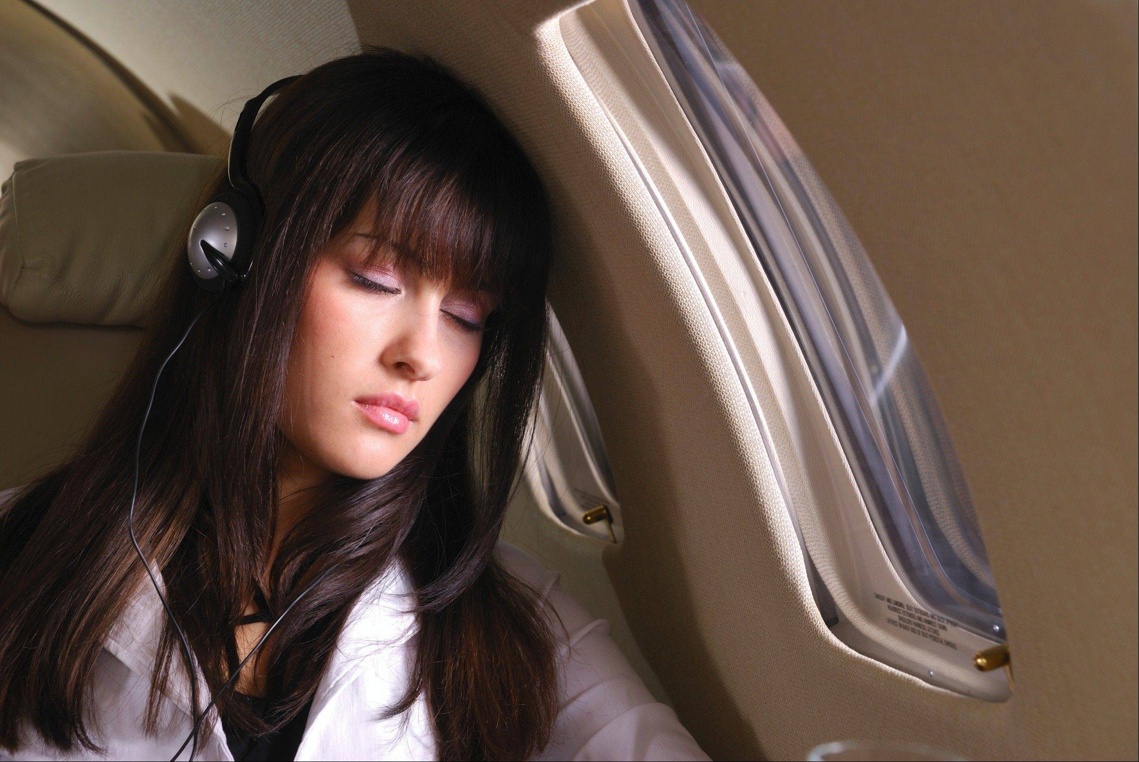 Picking the right seat and listening to music can help put you in the right mode for sleep when flying.