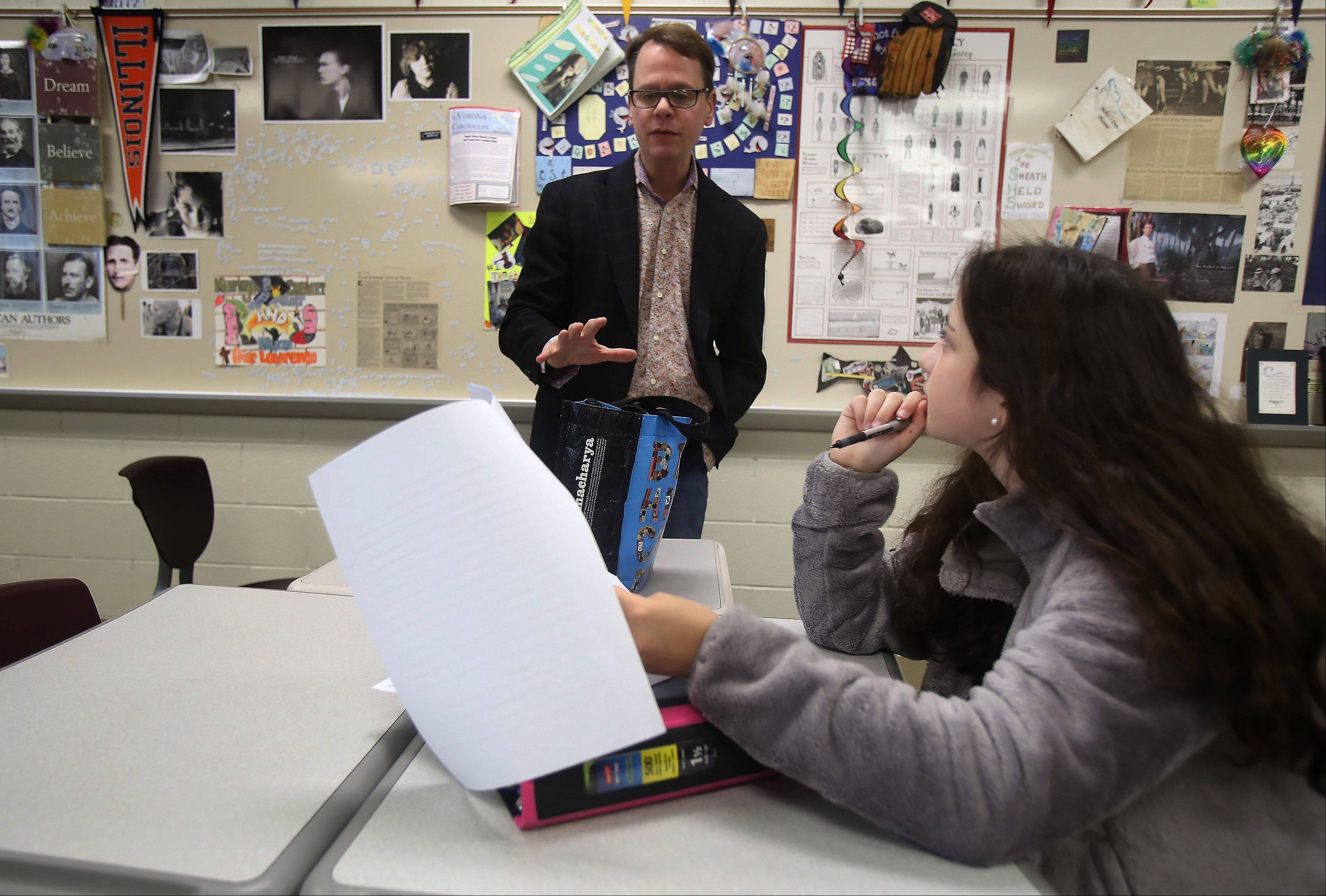 "Stevenson High School communications arts teacher Bill Fritz works with freshman Hannah Aronson on her paper on the book ""To Kill A Mockingbird"" before class."