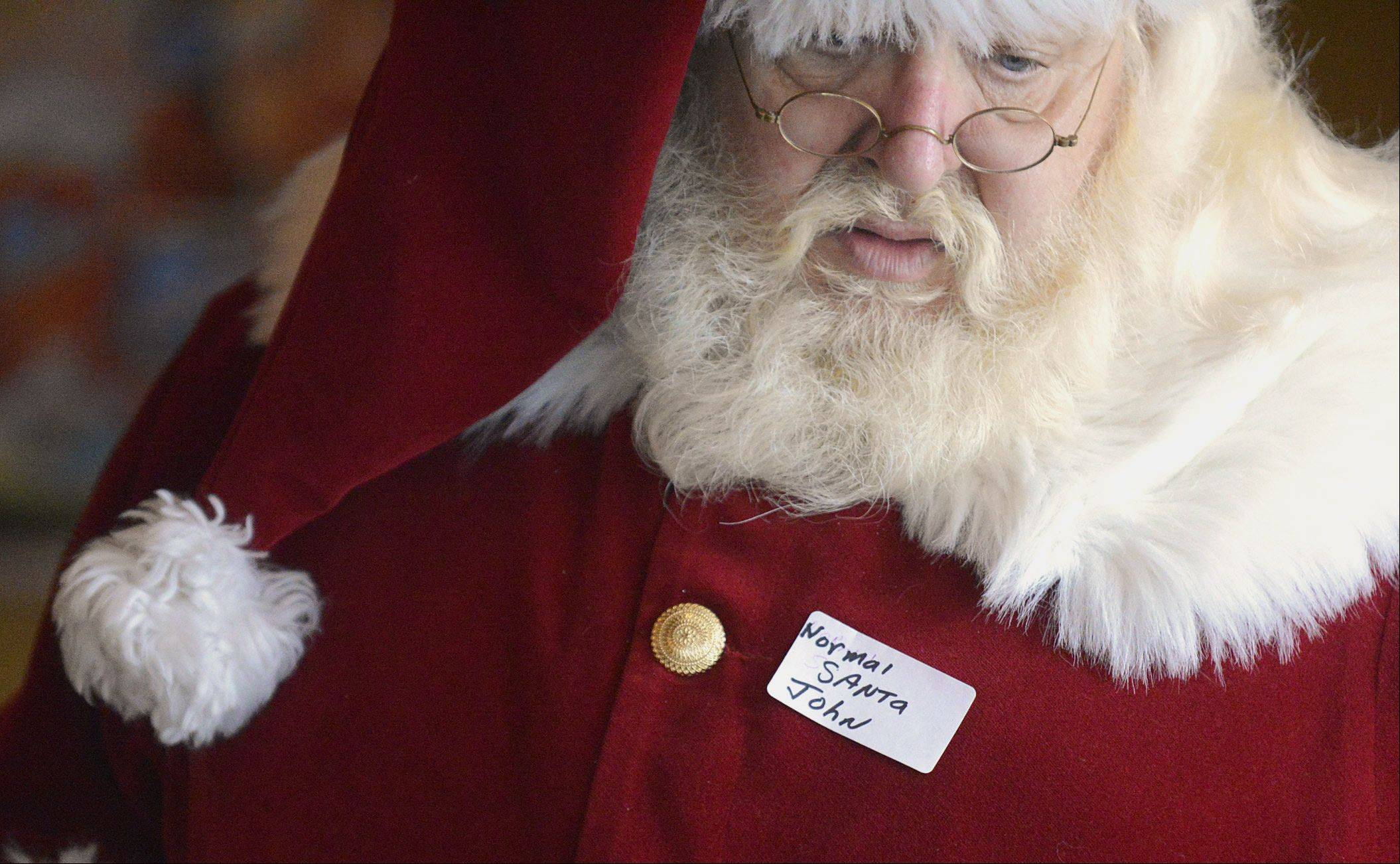 John Medley of Normal arrived in full costume for the gathering of Santas and Mrs. Santas of Illinois Saturday in Aurora. Medley has been Santa for 38 years and his wife Dorothy has been Mrs. Claus for 32 years.