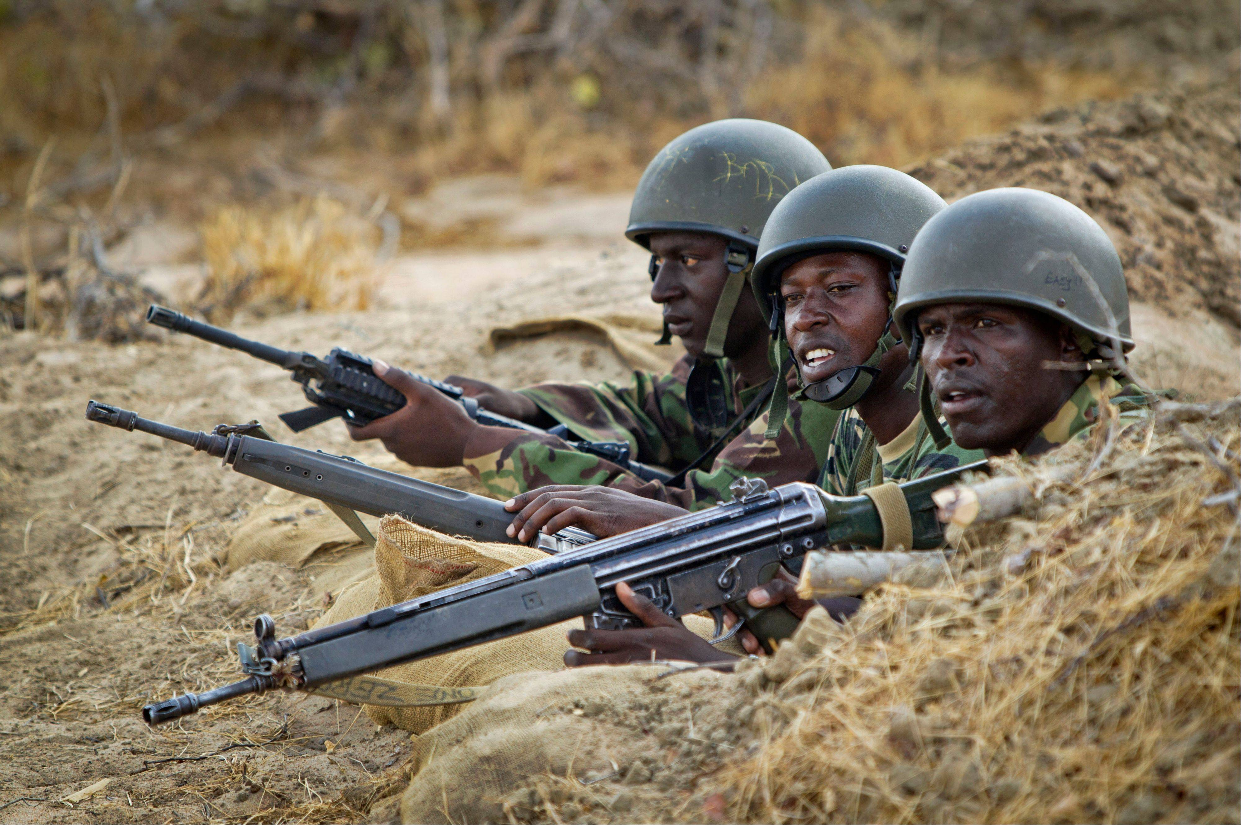 Kenyan army soldiers stand in a dugout position at their base in Tabda, inside Somalia. The Kenyan military said Friday that it has killed at least 30 Islamic militants in an airstrike on a militant camp in Garbarahey in the Gedo region of Somalia on Thursday, where a meeting was being held.