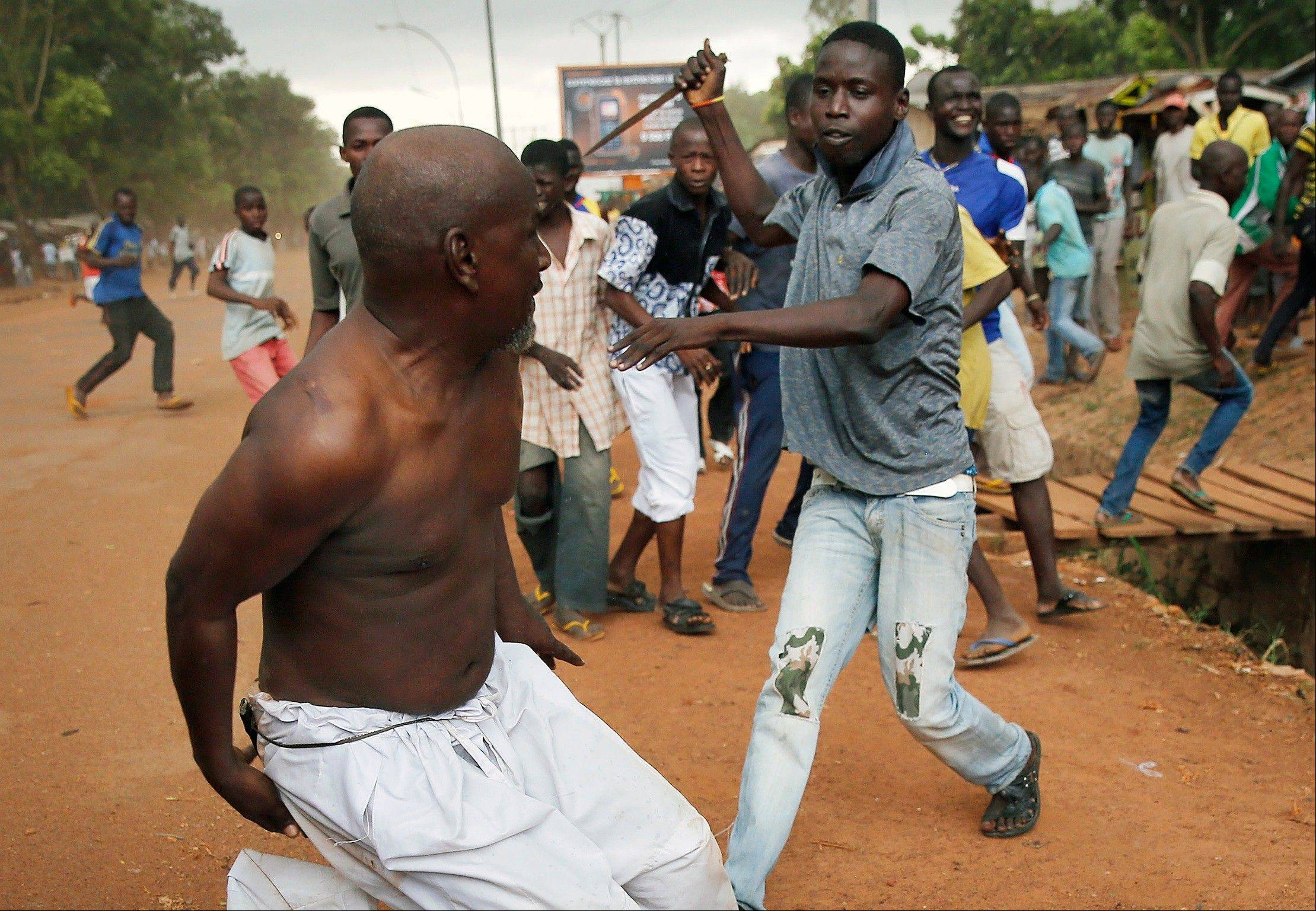 A Christian man chases a suspected Seleka officer in civilian clothes with a knife near the airport in Bangui, Central African Republic. Sub-Saharan Africa has seen a very violent start to 2014.