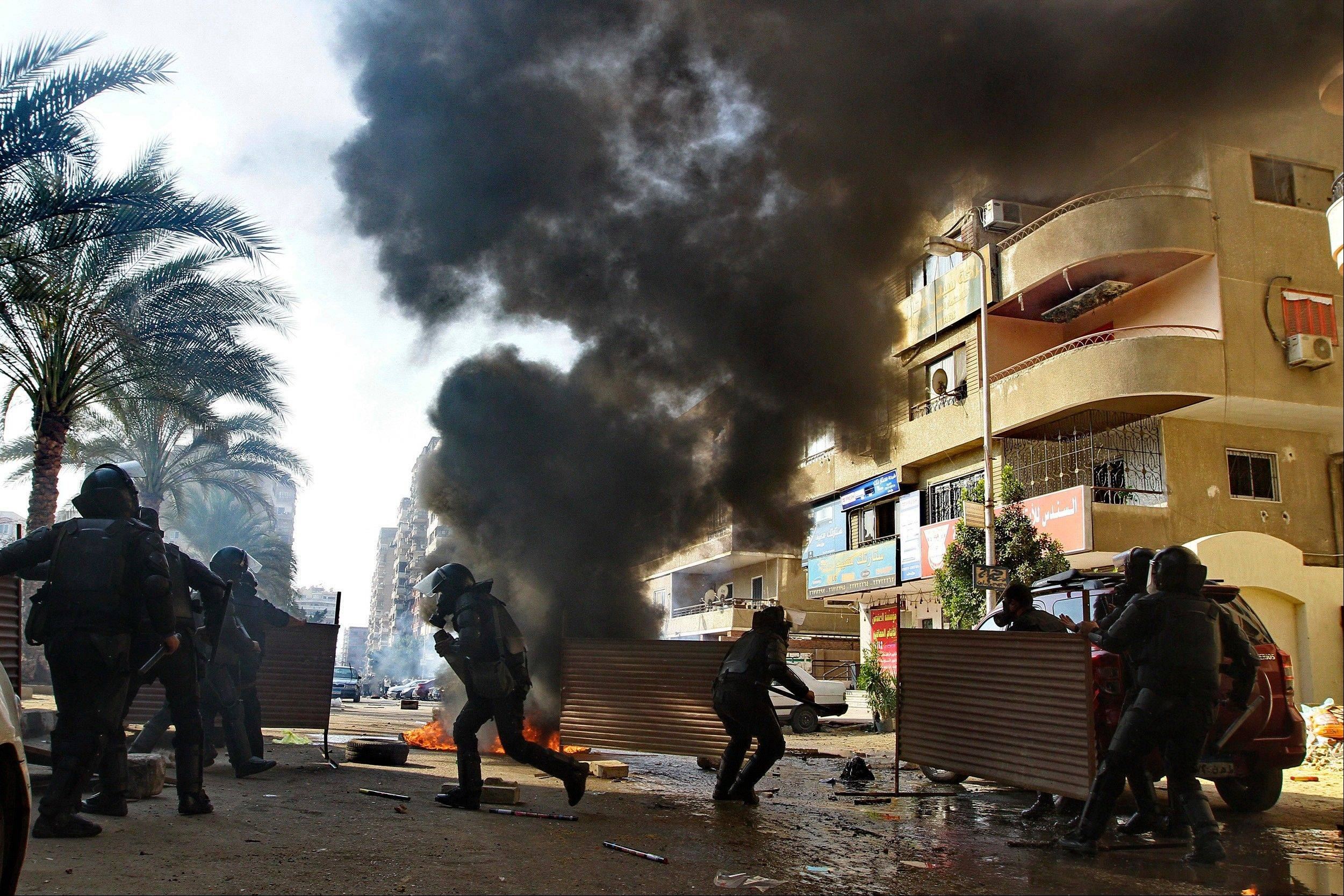 Egyptian security forces clash Friday with supporters of ousted President Mohamed Morsi in the Nasr City district of Cairo.