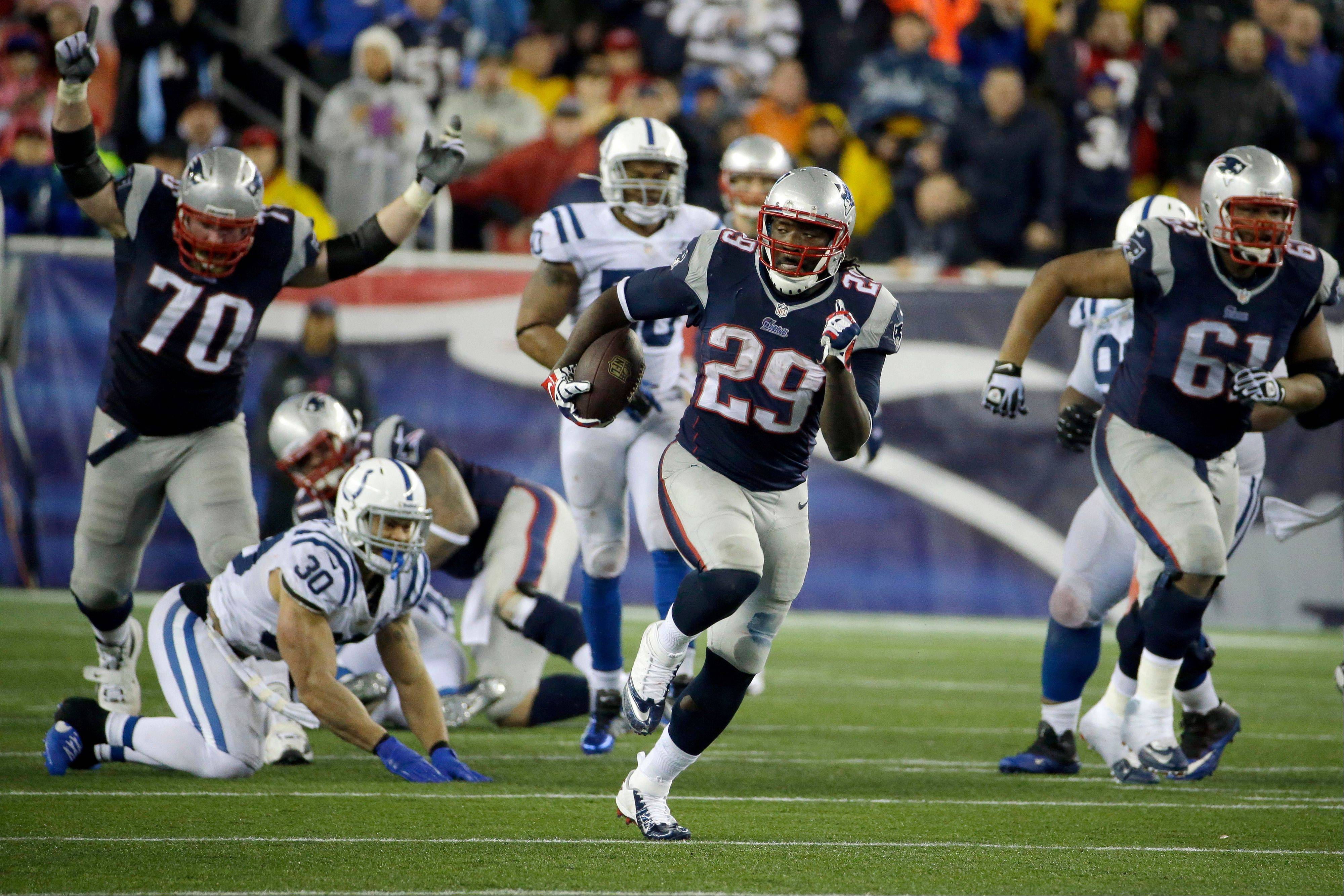 New England Patriots running back LeGarrette Blount heads downfield for a touchdown (his fourth in the game) as the Patriots ran past the Indianapolis Colts to advance to the AFC Championship game.