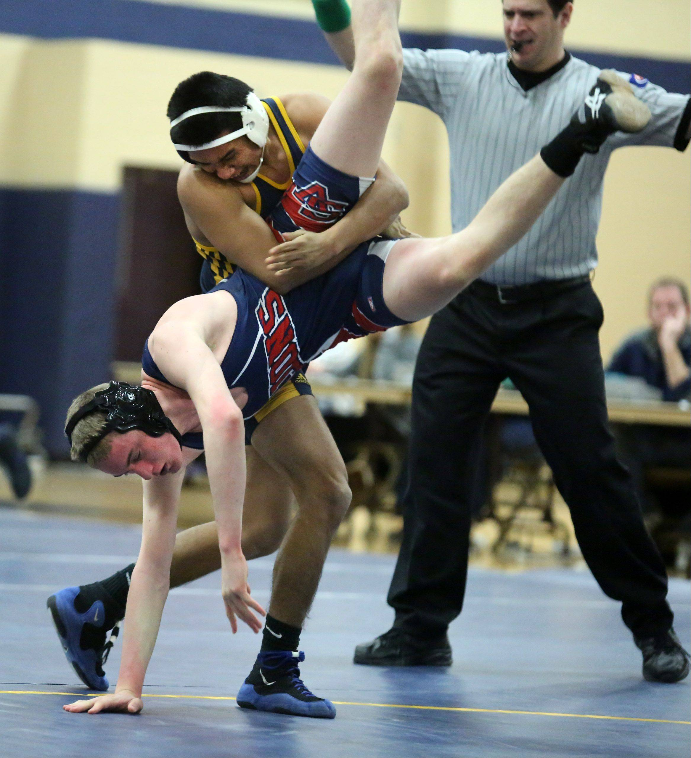 Round Lake's Juan Mena flips St. Viator's Arlan Hermanson as Mena wins the 160-pound match at Round Lake on Saturday.