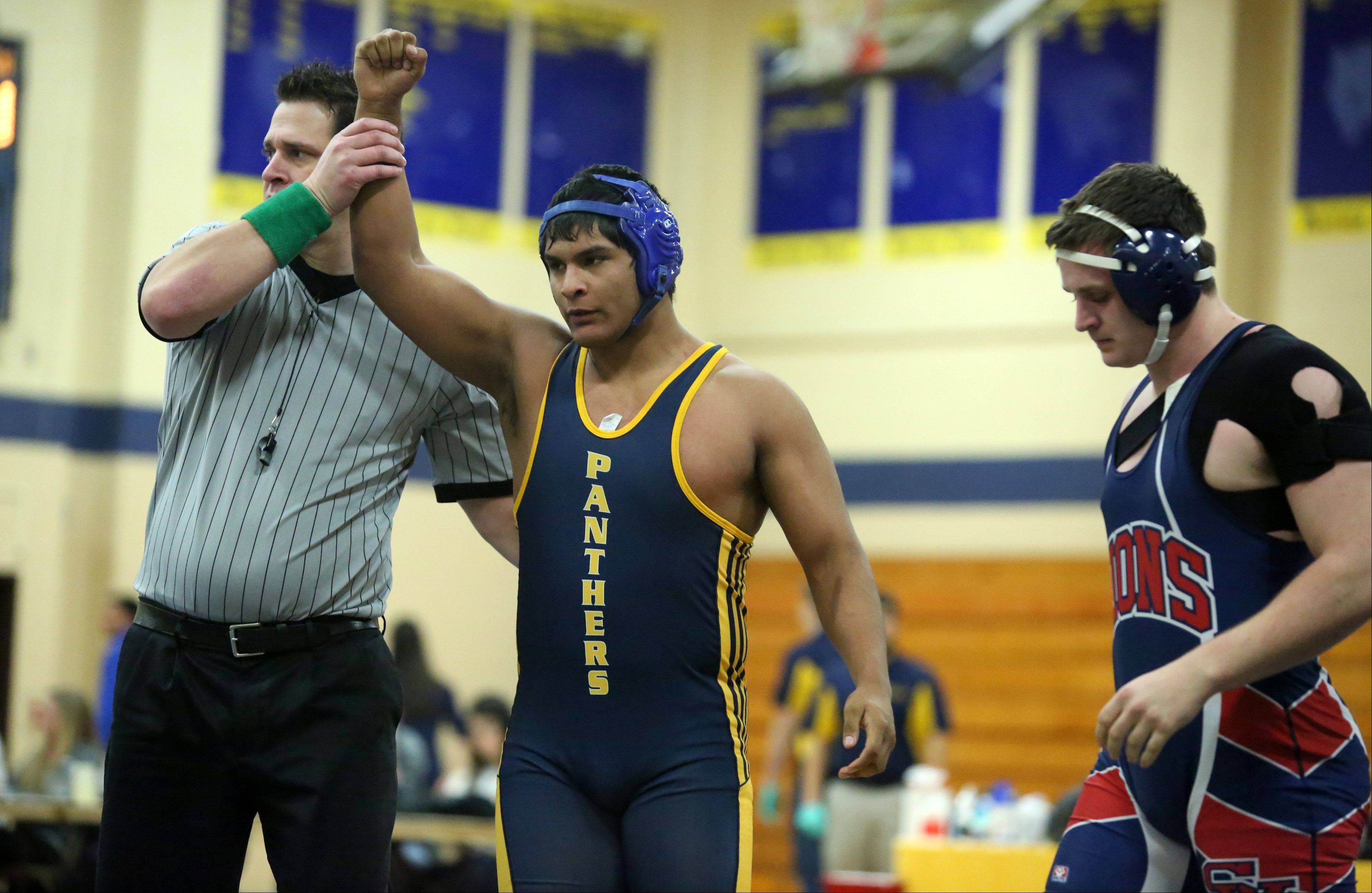 Round Lake's Algustine Bahena pins St. Viator's Charles Walberg in a 220-pound match at Round Lake wrestling meet on Saturday.