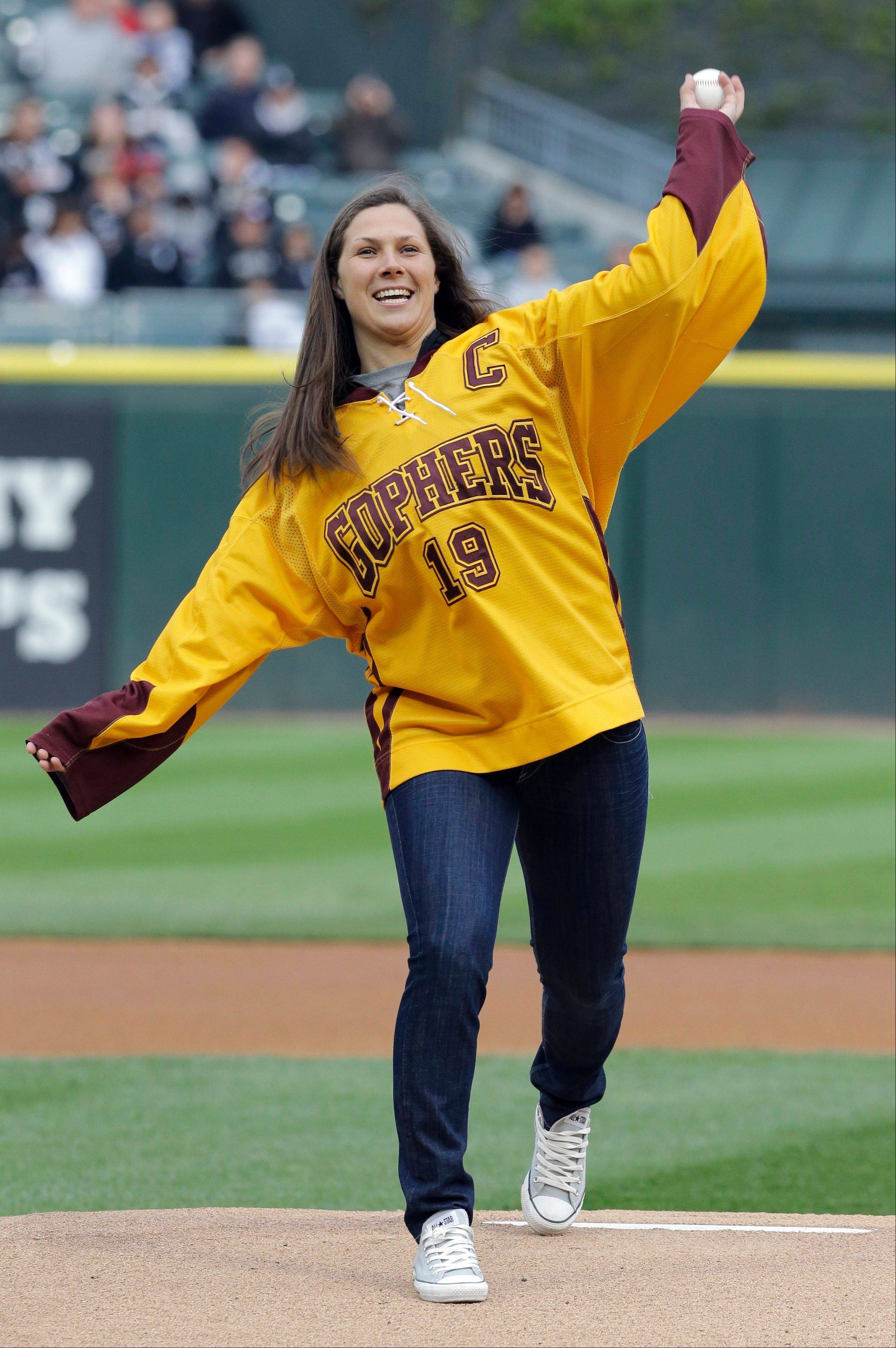 Former Minnesota women's hockey star Megan Bozek threw out a ceremonial first pitch before a baseball game between the Los Angeles Angels and the Chicago White Sox in Chicago last May. Next month she'll play for Team USA in Sochi, Russia.