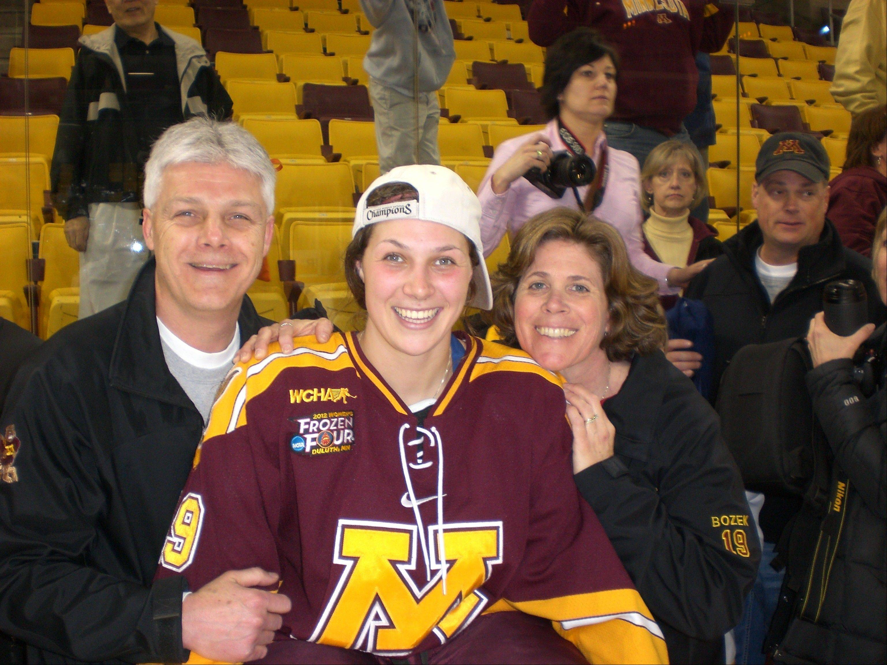 Buffalo Grove native Megan Bozek, who helped the University of Minnesota women's hockey team win consecutive NCAA championships, is headed to Socci to play in the 2014 Winter Olympics. Bozek, shown here with parents Tom and Patti Bozek after the 2012 National Championship game, was a standout defenseman at Minnesota.