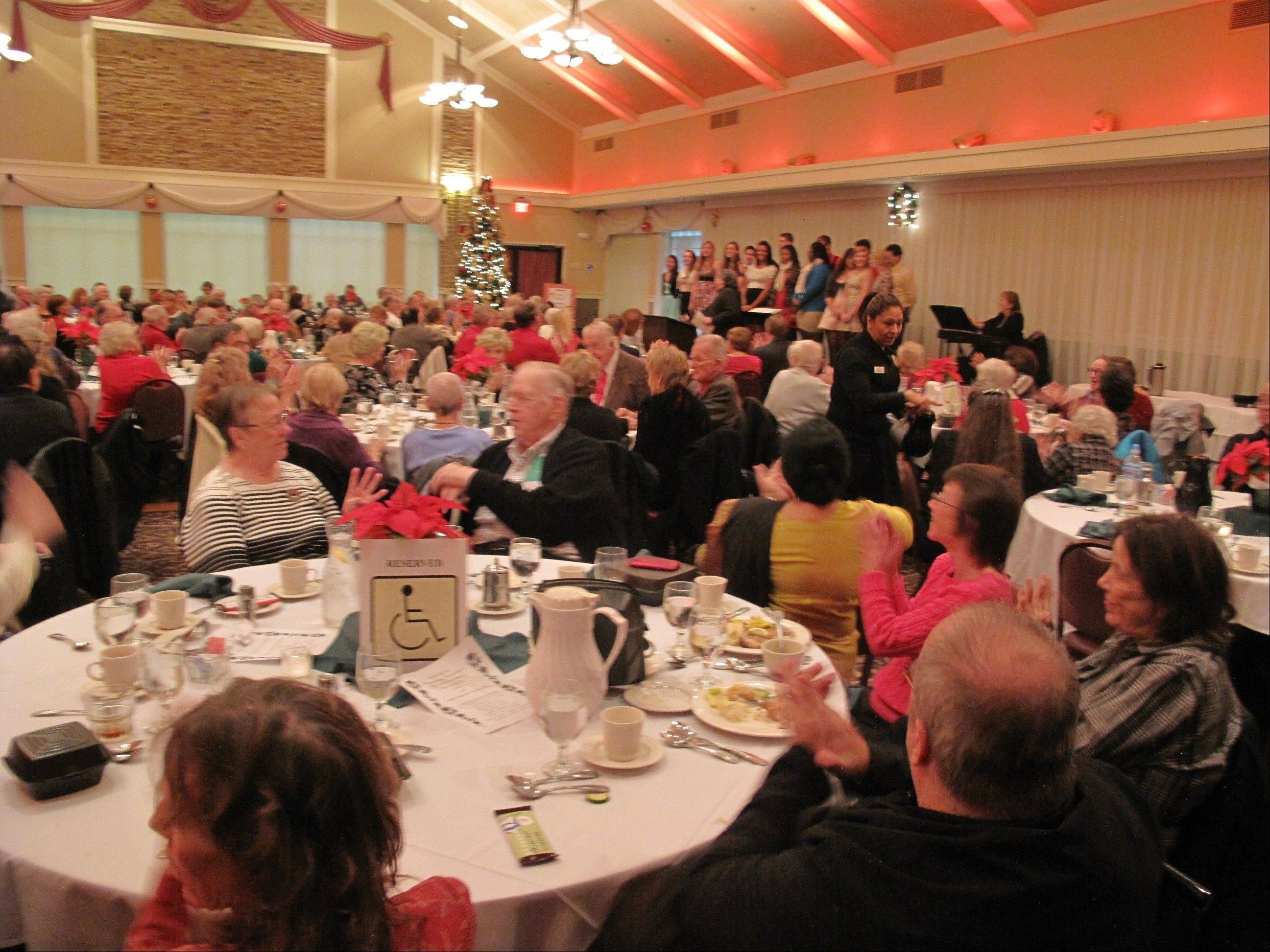 Attendees of the Schaumburg Township Senior and Disability Holiday Party enjoy a performance by the Schaumburg High School Choraliers Dec. 4 at Chandler's Chophouse in Schaumburg.