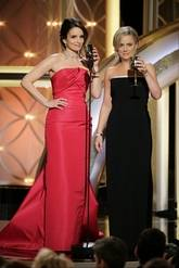 Golden Globes hosts Tina Fey and Amy Poehler make a toast at the end of their emcee gig Sunday night.