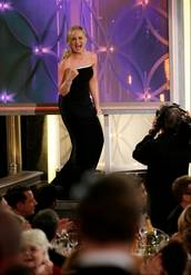 """Amy Poehler reacting after winning best actress in a TV comedy series for her role in """"Parks and Recreation"""" during the 71st annual Golden Globe Awards at the Beverly Hilton Hotel on Sunday in Beverly Hills, Calif."""