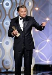 """This image released by NBC shows Leonardo DiCaprio accepting the award for best actor in a motion picture comedy for his role in """"The Wolf of Wall Street"""" during the 71st annual Golden Globe Awards at the Beverly Hilton Hotel on Sunday in Beverly Hills, Calif."""