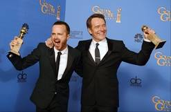 """Aaron Paul, left, and Bryan Cranston pose in the press room with the award for best TV series - drama for """"Breaking Bad"""" at the 71st annual Golden Globe Awards at the Beverly Hilton Hotel on Sunday in Beverly Hills, Calif."""