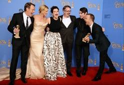 """From left, Bryan Cranston, Anna Gunn, Betsy Brandt, Vince Gilligan, RJ Mitte, and Aaron Paul pose in the press room with the award for best tv series - drama for """"Breaking Bad"""" at the 71st annual Golden Globe Awards at the Beverly Hilton Hotel on Sunday in Beverly Hills, Calif."""