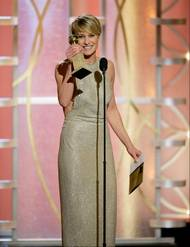 """This image released by NBC shows Robin Wright accepting the award for best actress in a drama TV series for her role in """"House of Cards"""" during the 71st annual Golden Globe Awards at the Beverly Hilton Hotel on Sunday in Beverly Hills, Calif."""