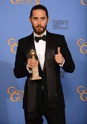 """Jared Leto poses in the press room with the award for best supporting actor in a motion picture for """"Dallas Buyers Club"""" at the 71st annual Golden Globe Awards at the Beverly Hilton Hotel on Sunday in Beverly Hills, Calif."""