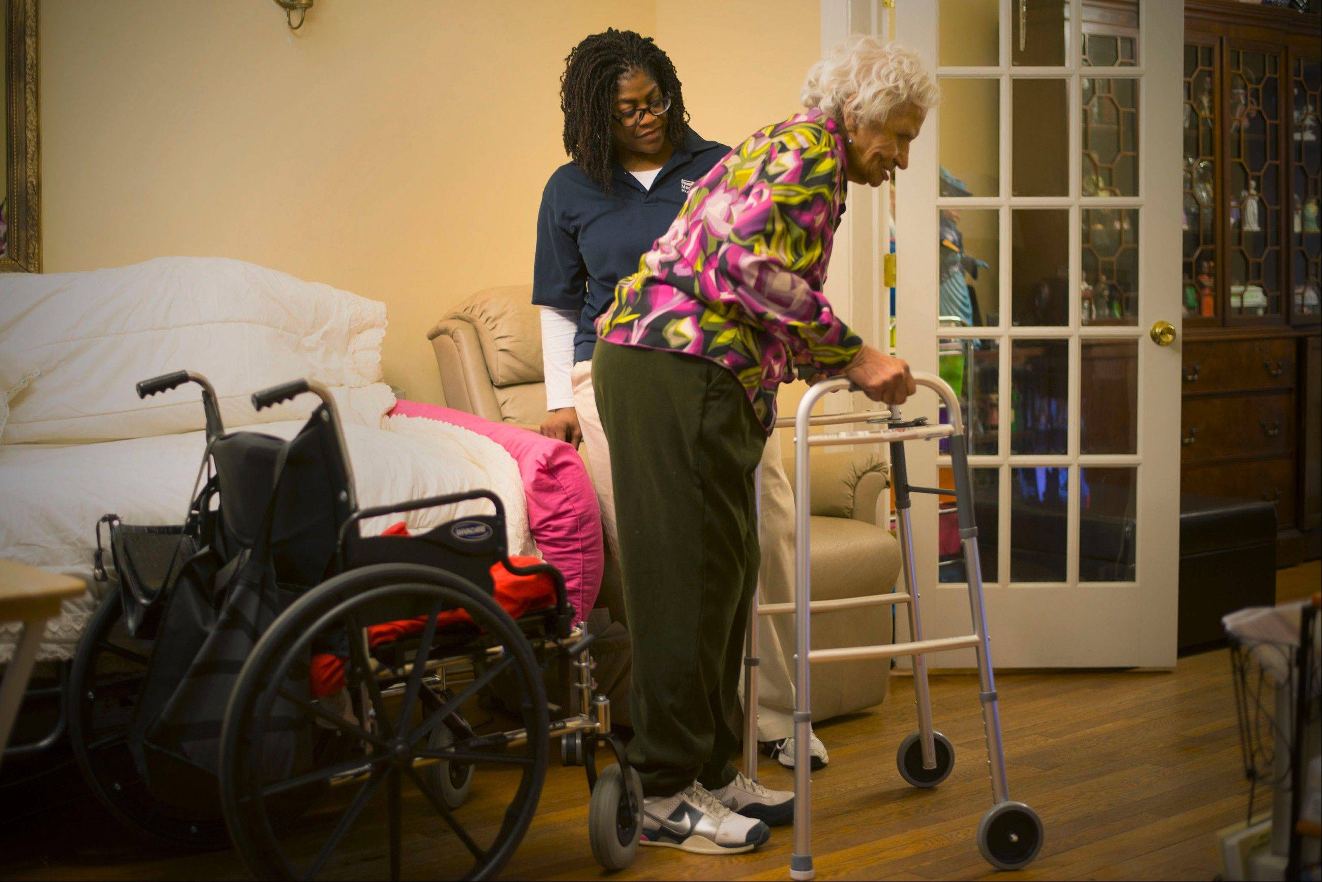 Sandra Mabry, left, helps Bobbie Jones with regularly scheduled physical therapy in December in Washington.