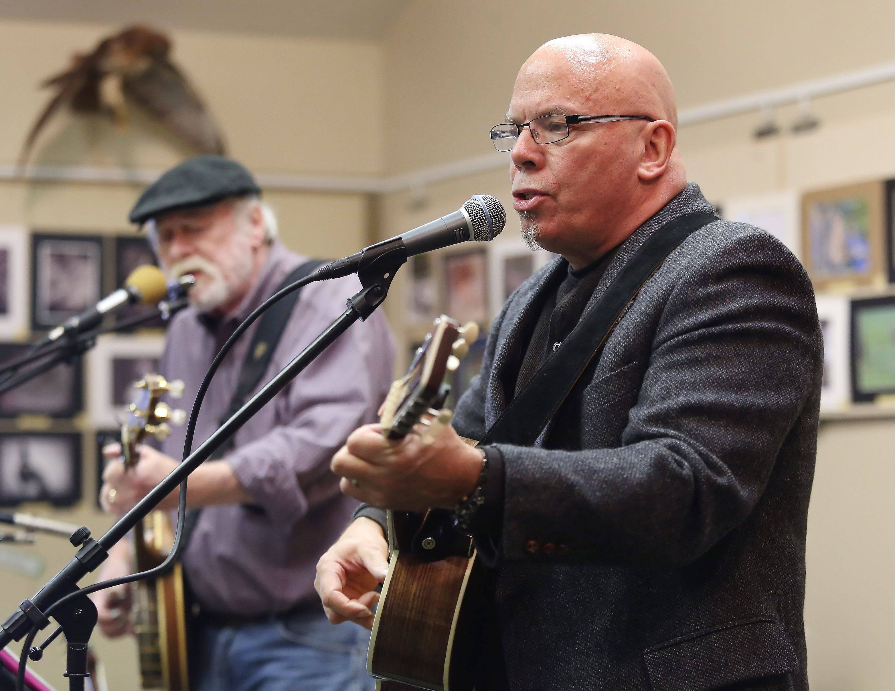 Will Kruger and Chris Strong sing John Denver�s �Country Roads� song during WinterFest at Volo Bog Natural Area on Sunday. The festival featured bog tours, a snow sculpture contest, a photo contest, winter crafts and live folk music.