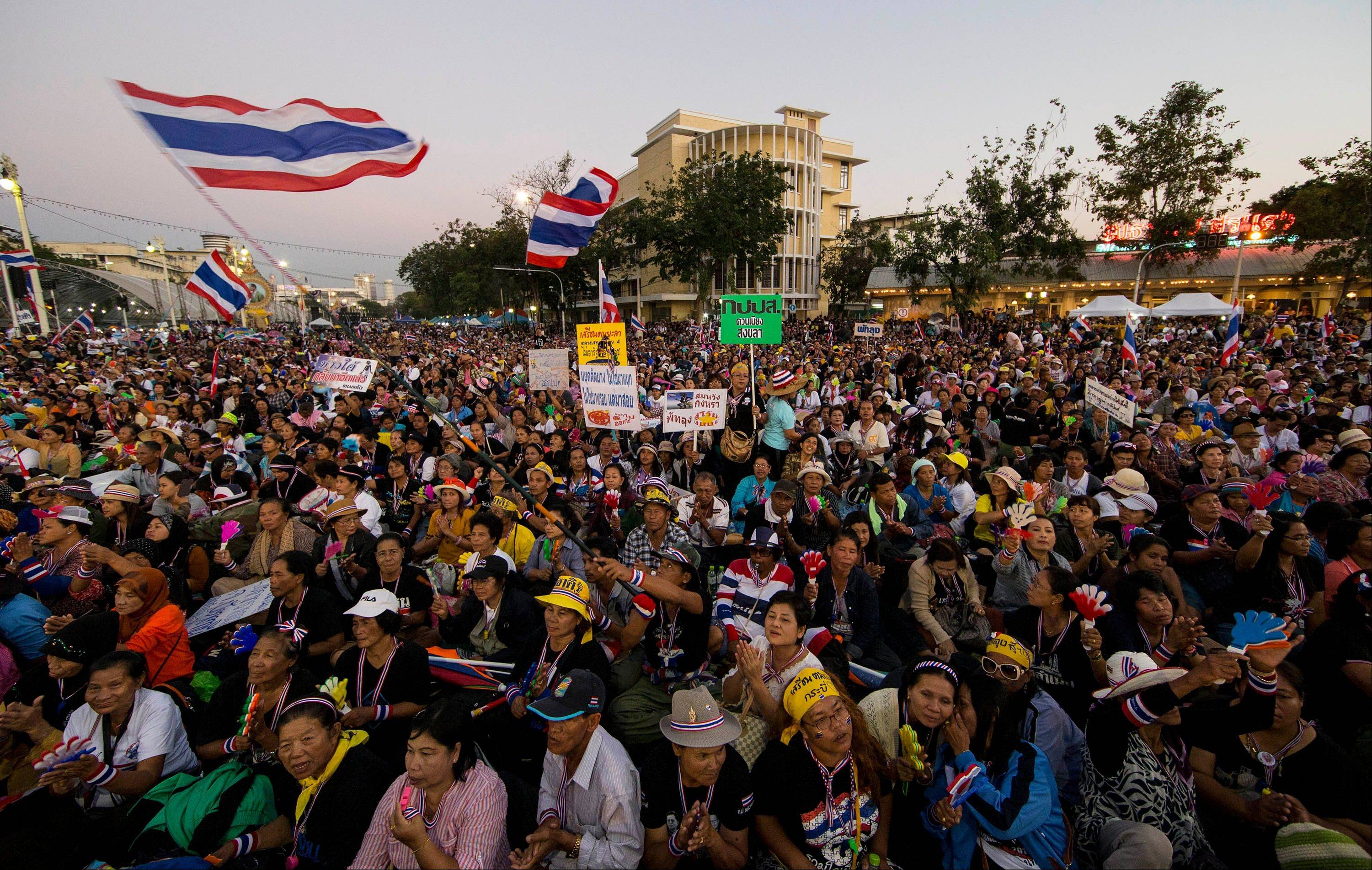 Thai anti-government protesters gather Sunday during a rally at the Democracy Monument in Bangkok.