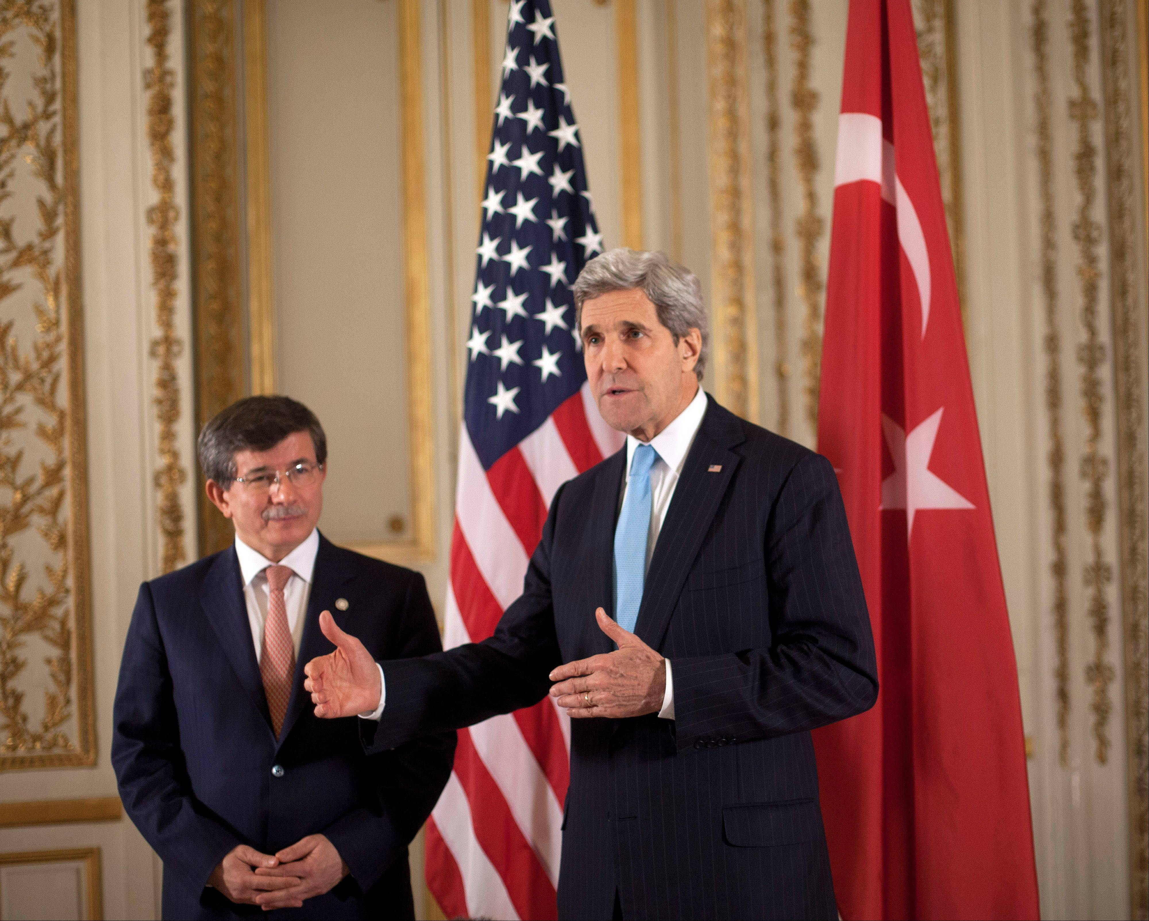 U.S. Secretary of State John Kerry, right, with Turkish Foreign Minister Ahmet Davutoglu, is in Paris for a two-day meeting to rally international support for ending the three-year civil war in Syria.