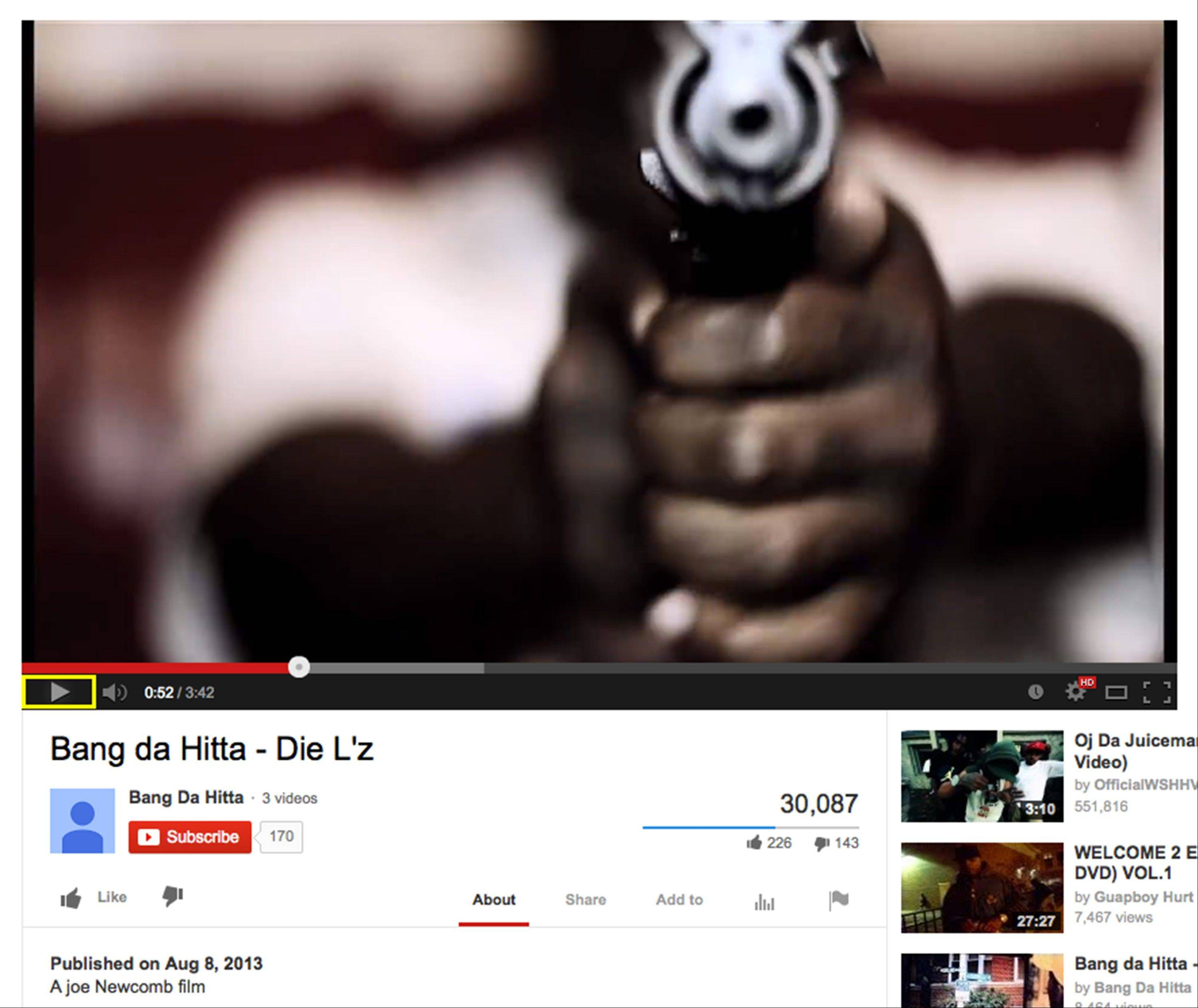 This image made from the YouTube website shows a still frame of the music video �Die L�z� by Bang Da Hitta posted on Aug. 8, 2013, with a man pointing a weapon at the camera. From the video, police in Chicago police identified two of those in the video as felons who are prohibited from being around guns.