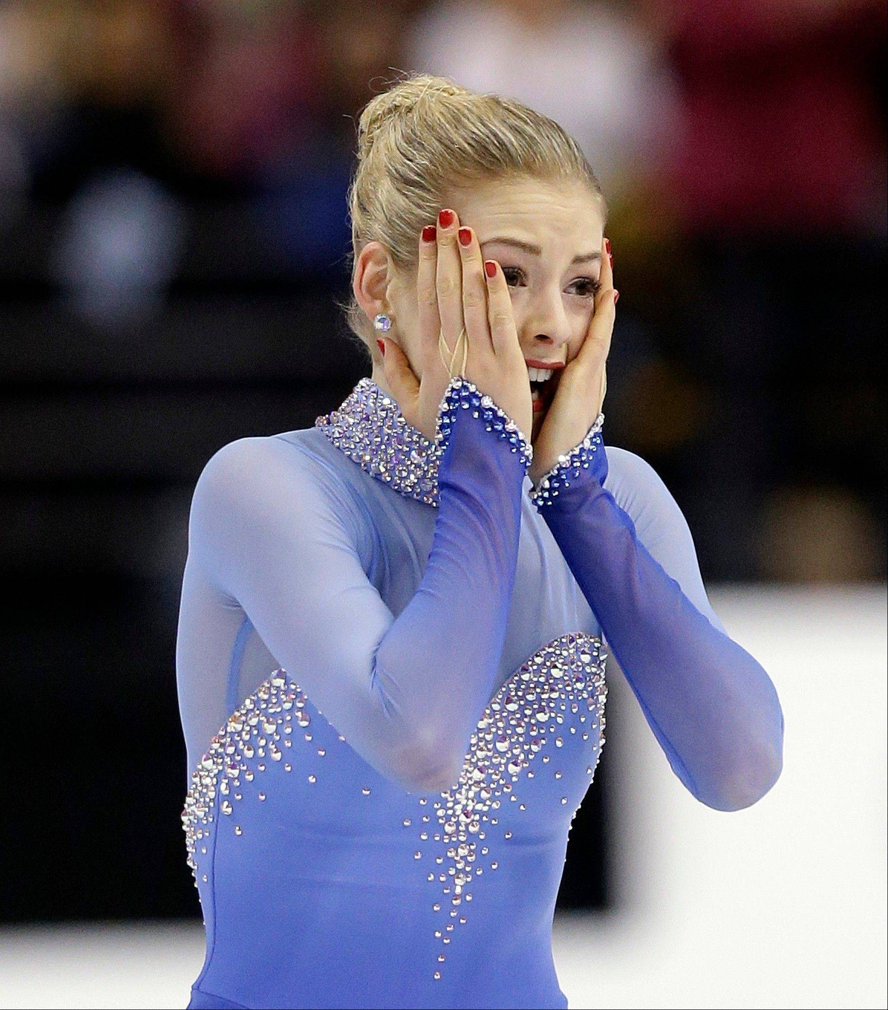Gracie Gold reacts after skating in the women's free skate at the U.S. Figure Skating Championships Saturday in Boston. Gold, 18, won her first U.S. title, posting 211.69 points to easily win the competition. The U.S. Olympic team will be announced on Sunday.
