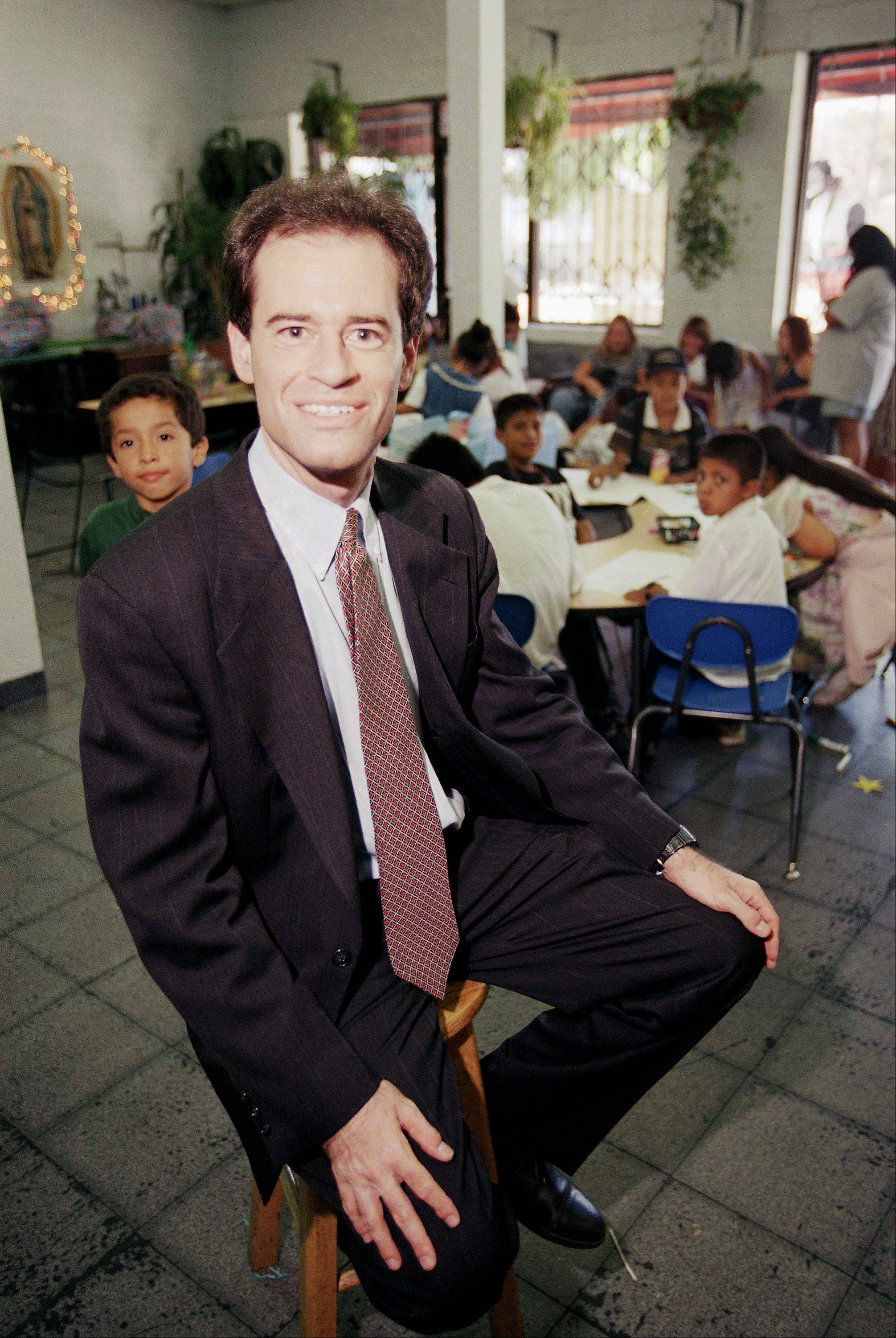 Ron Unz poses inside the Las Families Del Pueblo child care center in Los Angeles. Unz, a Silicon Valley multimillionaire and registered Republican who once ran for governor and, briefly, U.S. Senate, wants state voters to endorse the wage jump that he predicts would nourish the economy.