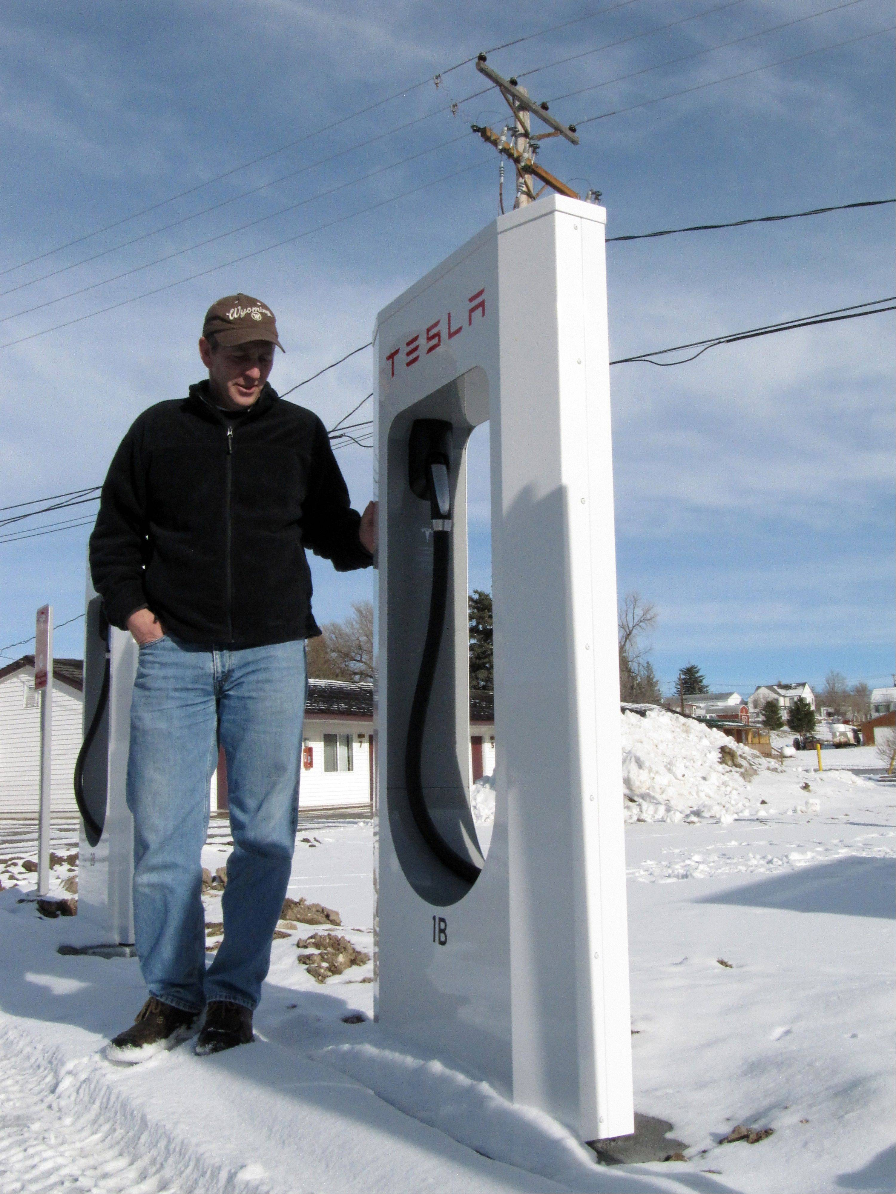 Mark Kupke, owner of the Covered Wagon Motel in Lusk, Wyo., stands next to one of four Tesla Supercharger units installed in December in the hotel courtyard. A Supercharger can recharge a Tesla's depleted battery pack to a 90-percent level within 45-50 minutes, several times faster than any other charging option for the electric cars. Lusk is on the route of Tesla's first network of coast-to-coast Supercharger stations. The quick-charge stations promise to make cross-country travel by Tesla much quicker and easier.