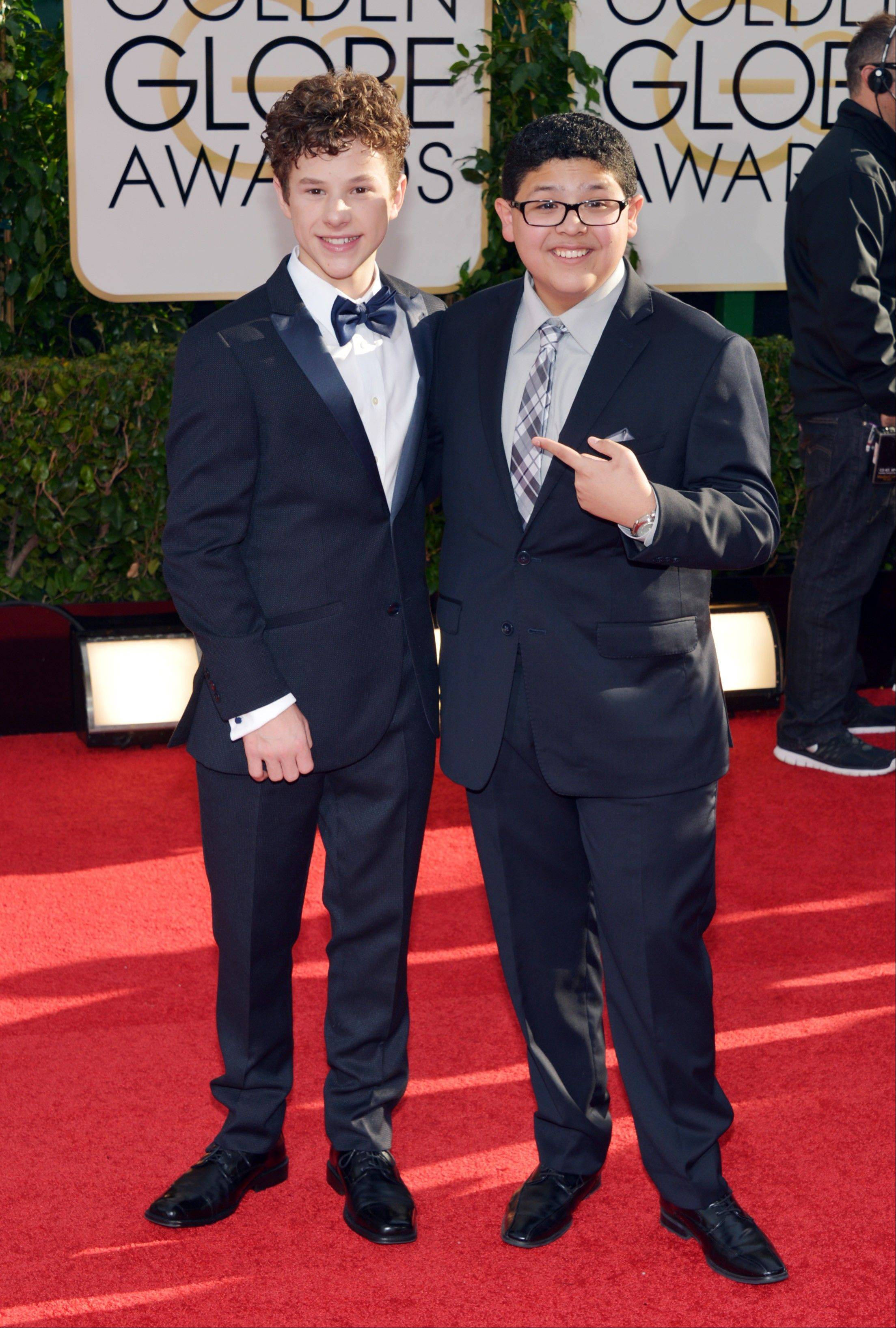 """Modern Family"" stars Nolan Gould, left, and Rico Rodriguez arrive at the 71st annual Golden Globe Awards."