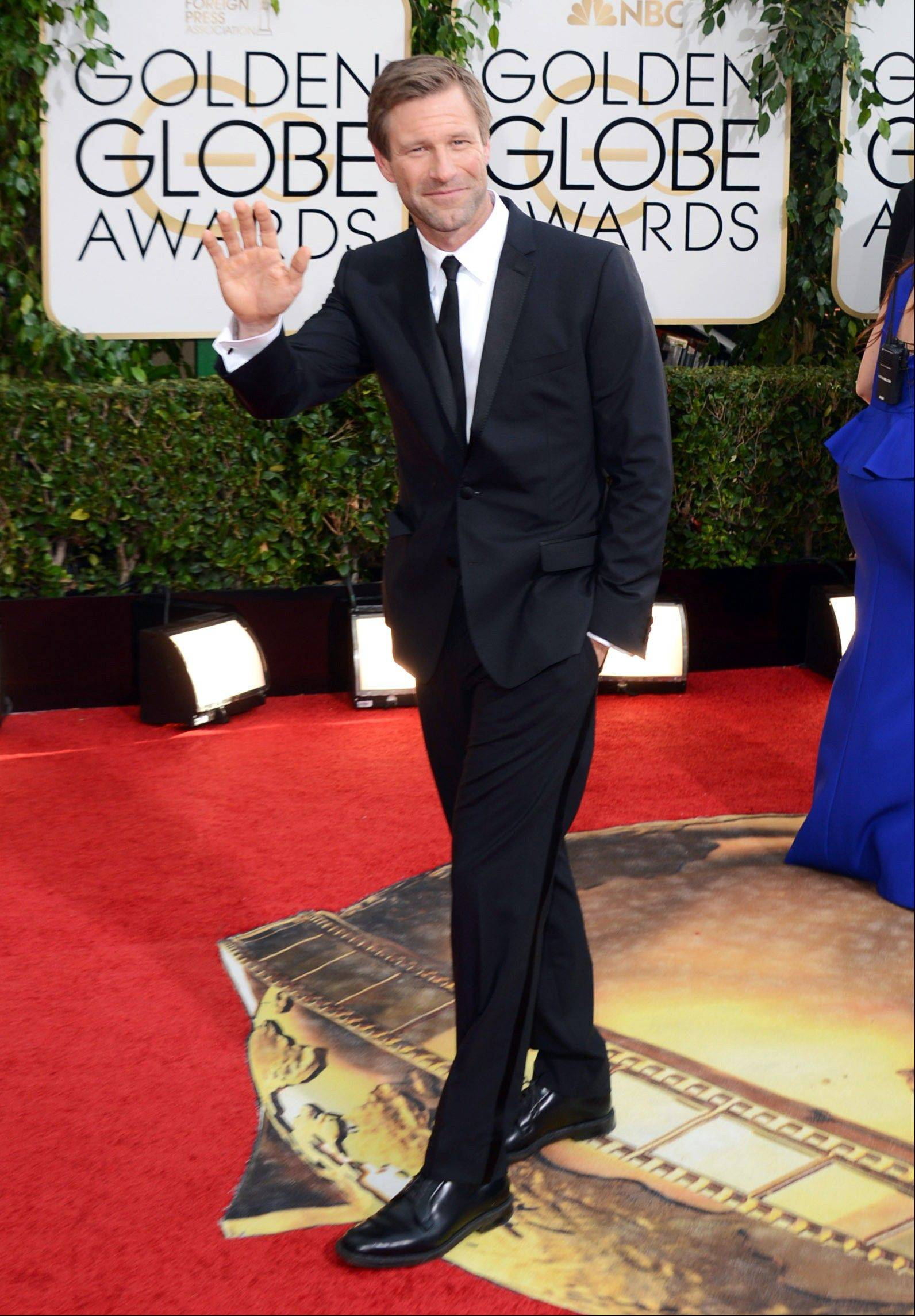 Actor Aaron Eckhart arrives at the 71st annual Golden Globe Awards.