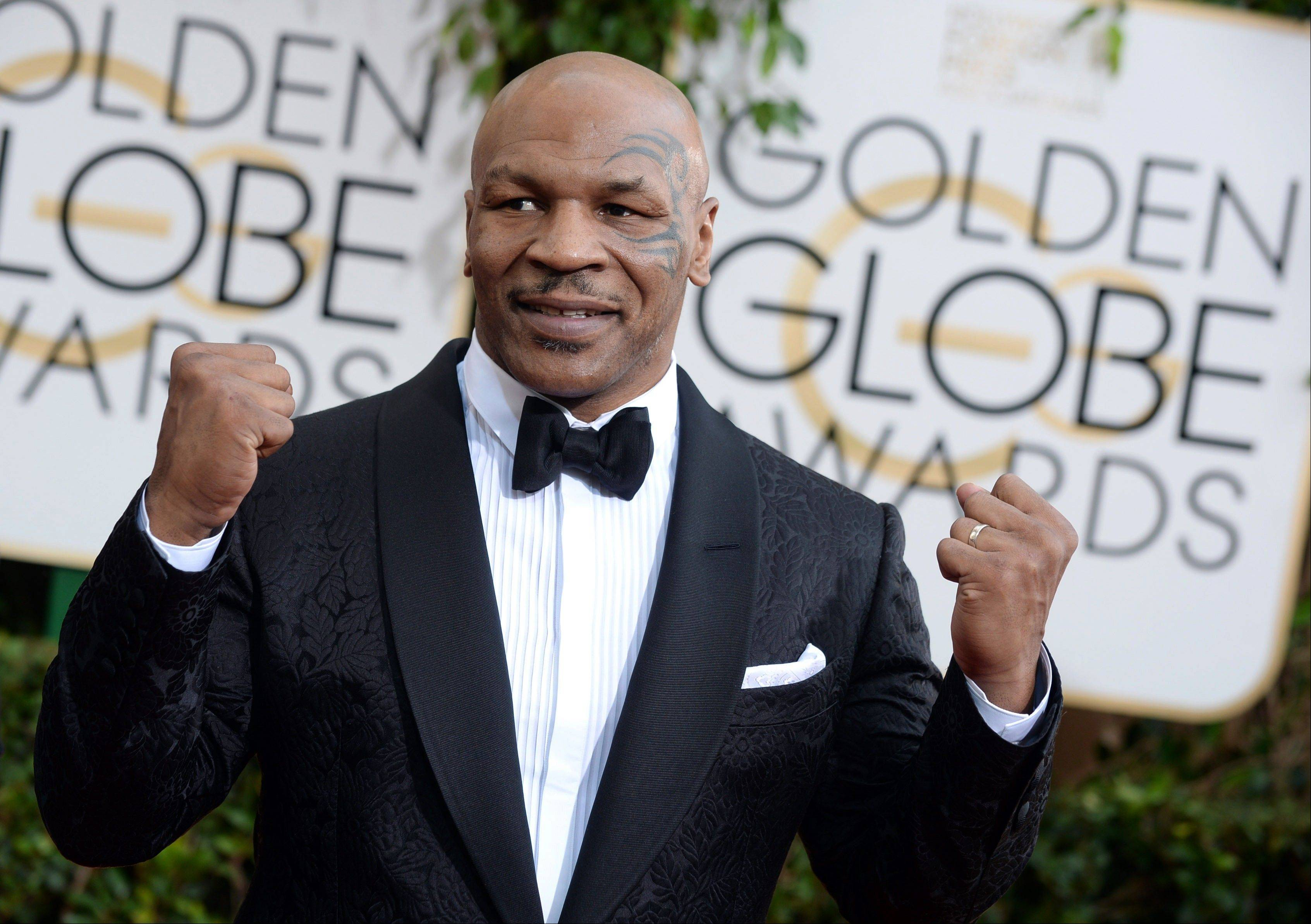 Mike Tyson arrives at the 71st annual Golden Globe Awards.
