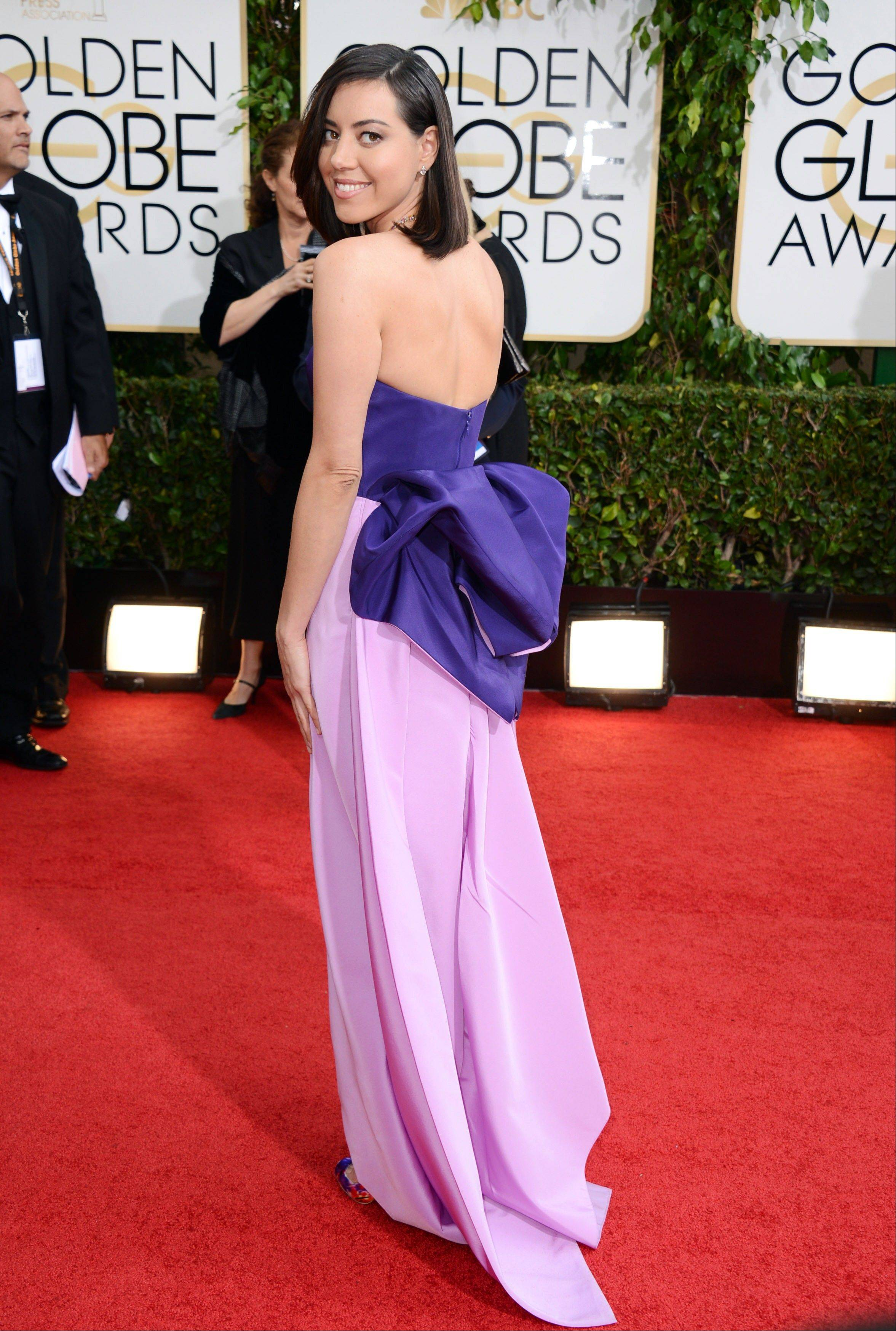 """Parks and Rec"" star Aubrey Plaza arrives at the 71st annual Golden Globe Awards."