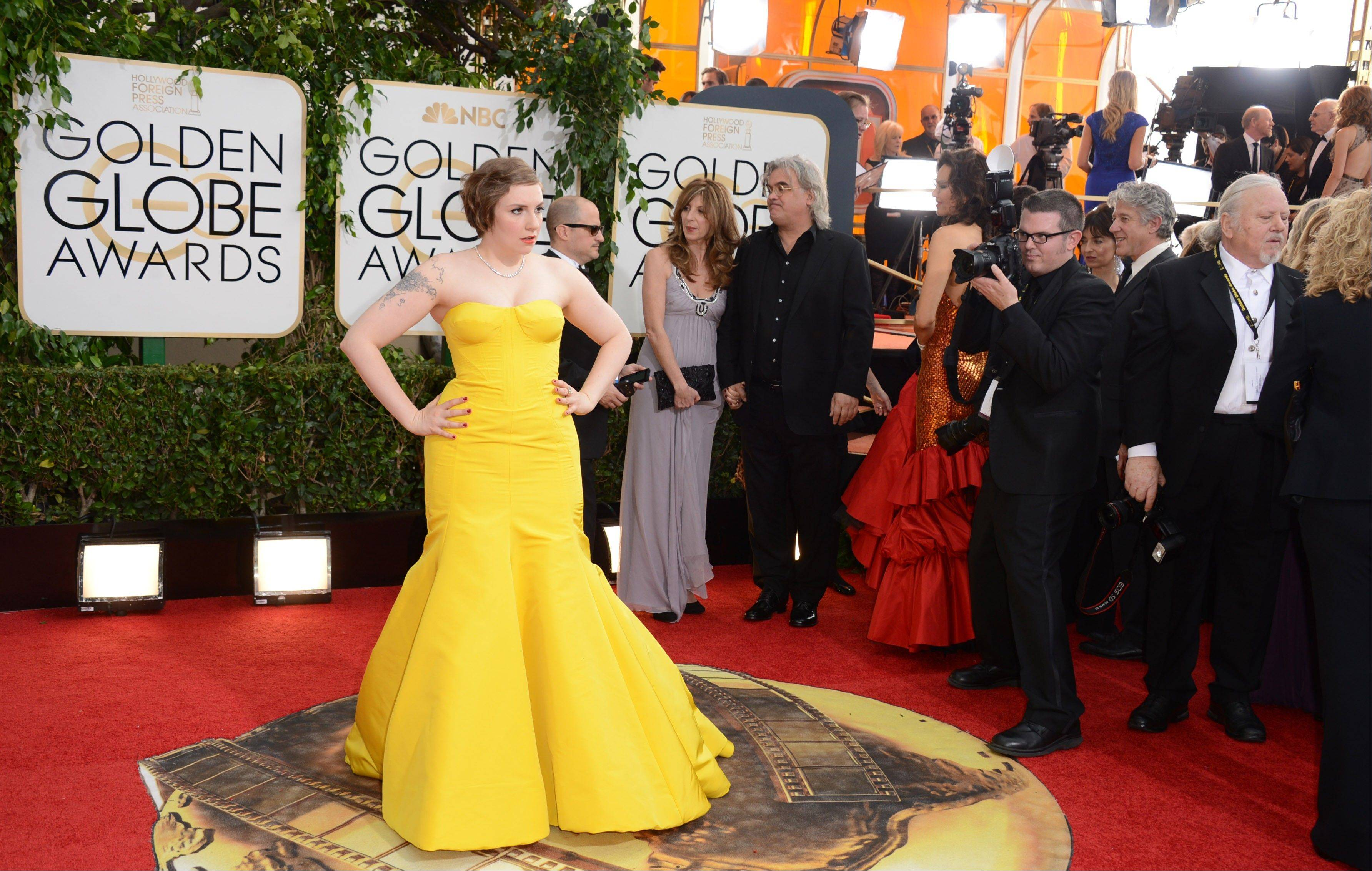 """Girls"" star/writer/producer Lena Dunham arrives at the 71st annual Golden Globe Awards."