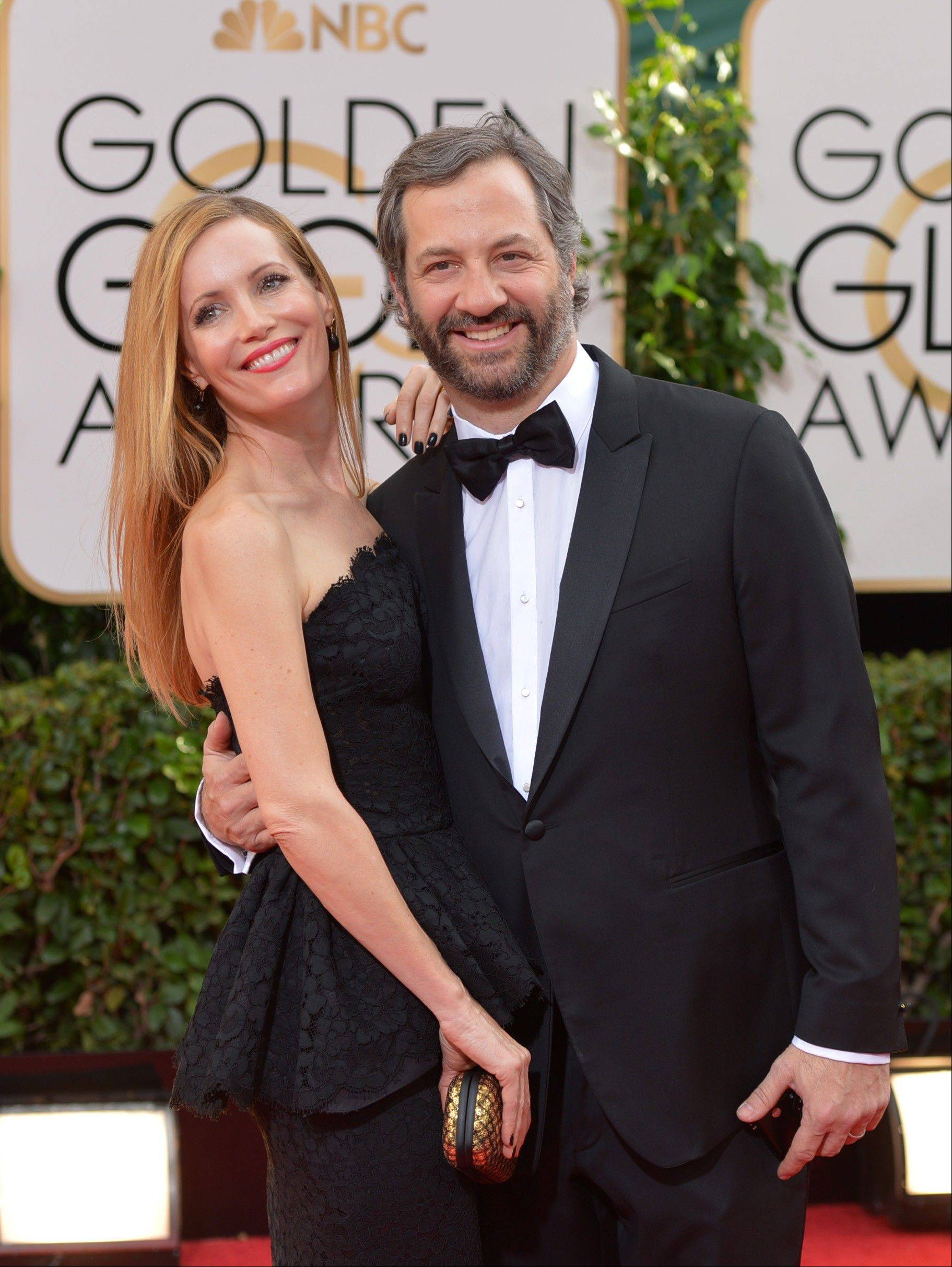 Actress Leslie Mann stayed closed to her husband producer/writer/director Judd Apatow as the couple made their way down the red carpet.