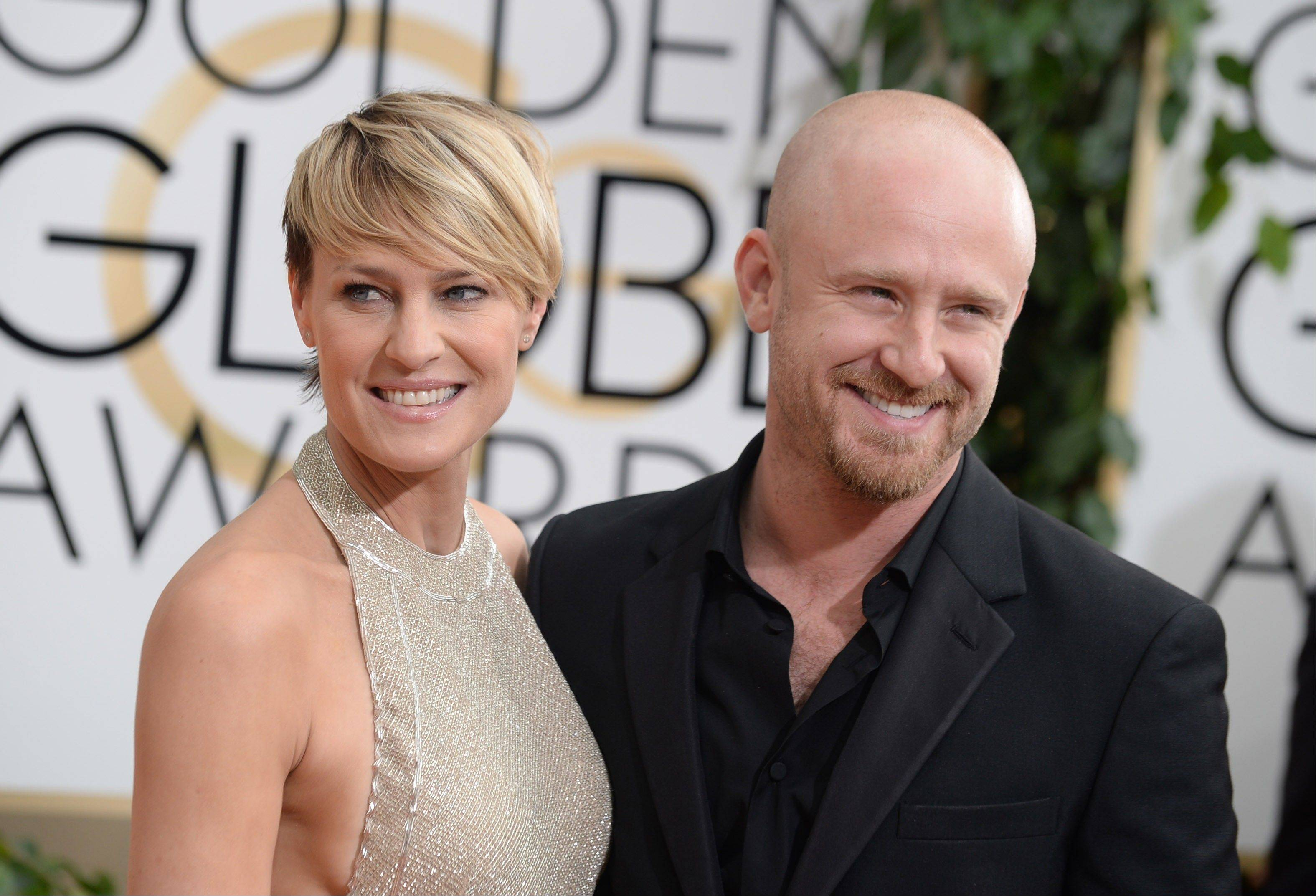 """House of Cards"" star Robin Wright walks the carpet with her fiance, actor Ben Foster."