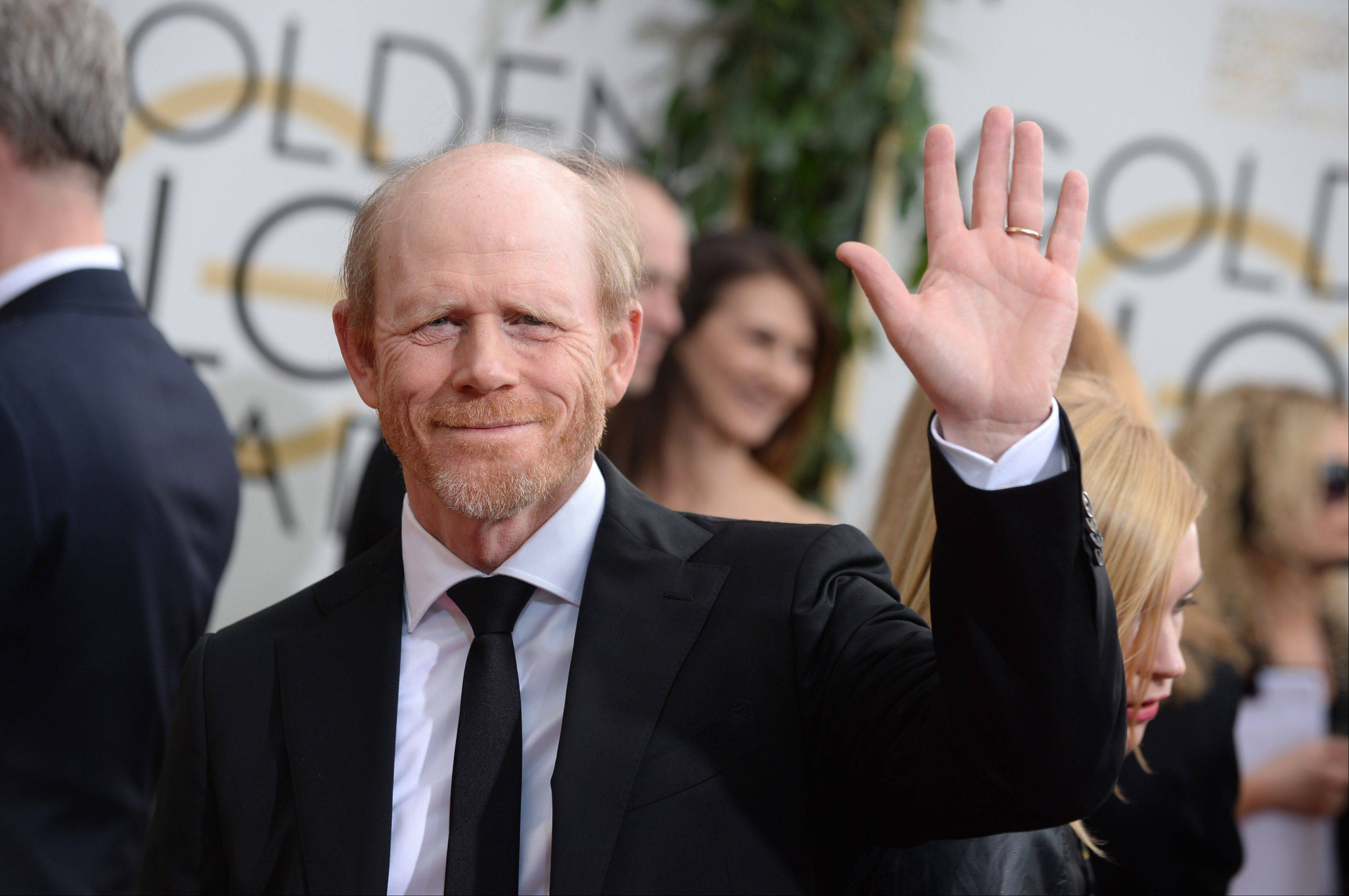 """Rush"" director Ron Howard arrives at the 71st annual Golden Globe Awards at the Beverly Hilton Hotel."