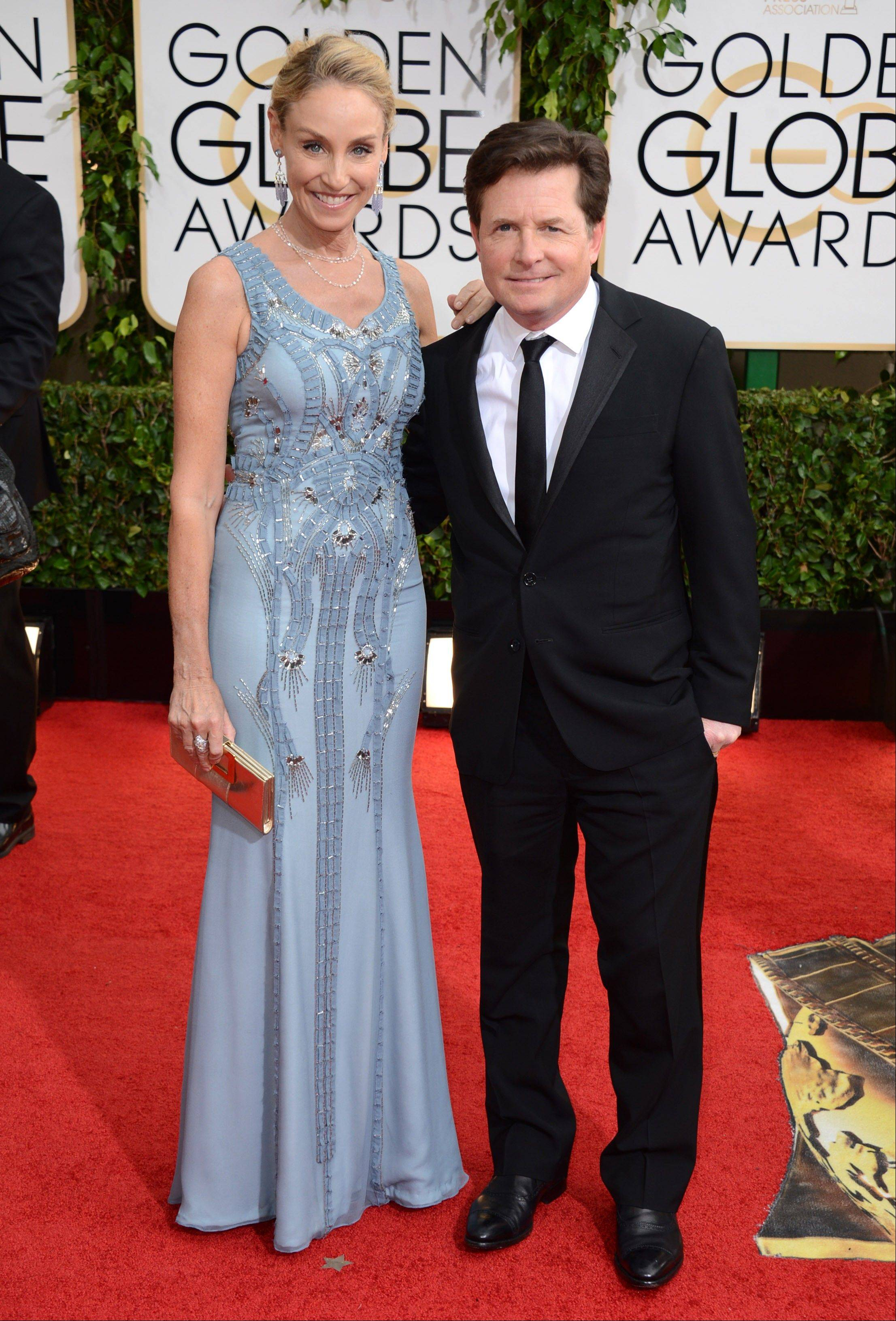 Tracy Pollan and Michael J. Fox arrive at the 71st annual Golden Globe Awards.