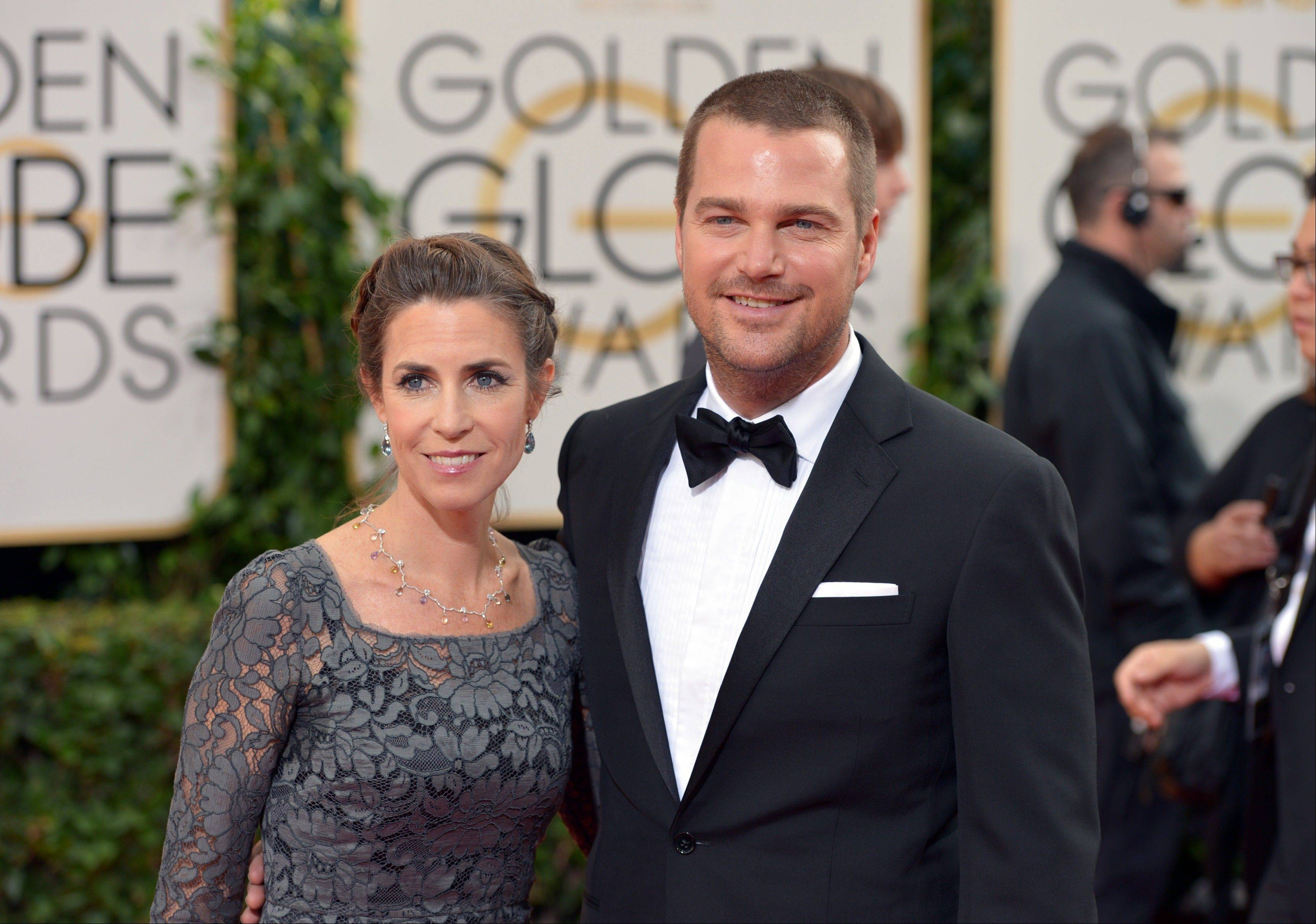 "Caroline Fentress and NCIS: Los Angeles"" star Chris O'Donnell arrive at the 71st annual Golden Globe Awards."
