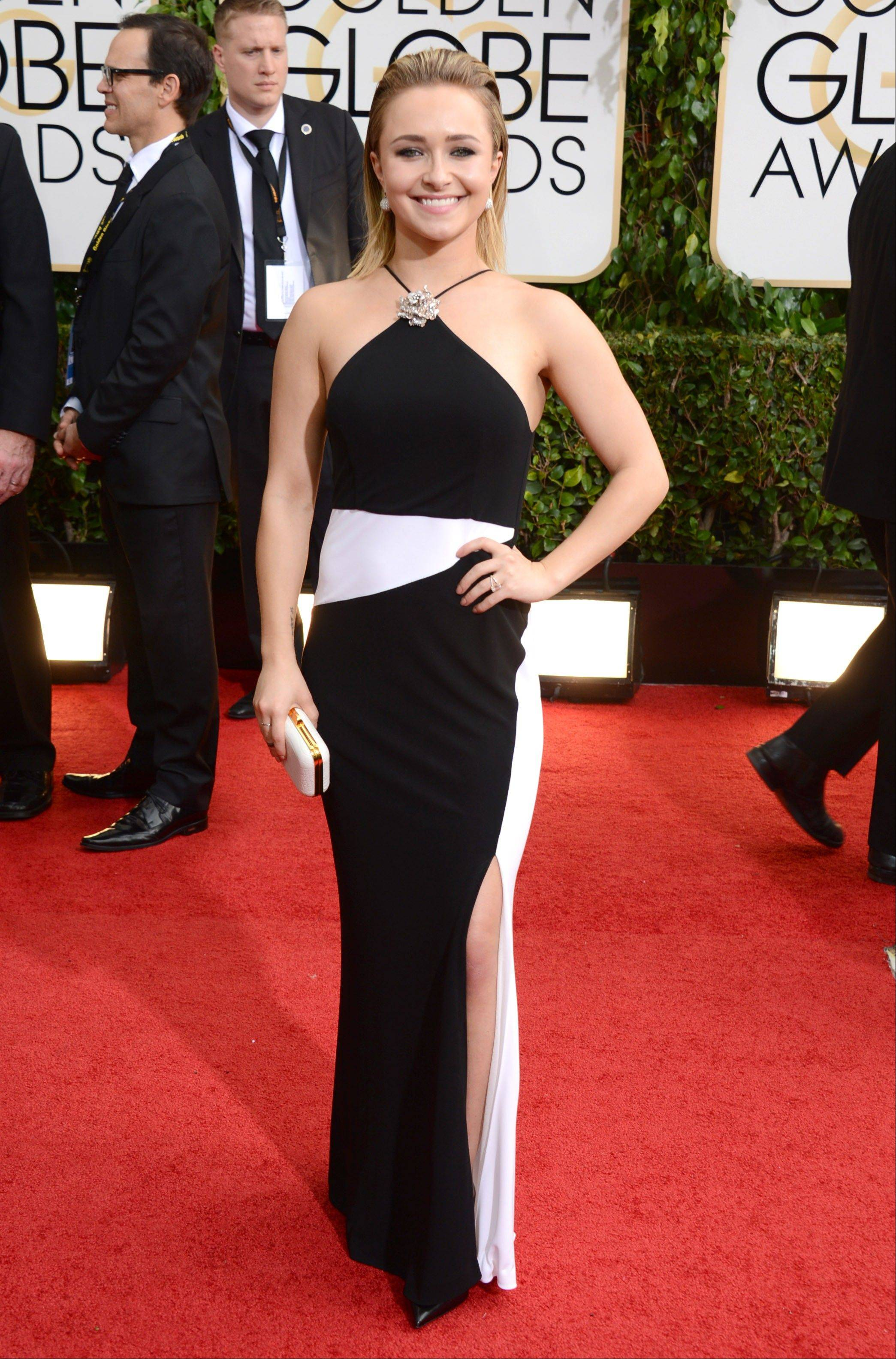 """Nashville"" star Hayden Panettiere arrives at the 71st annual Golden Globe Awards."