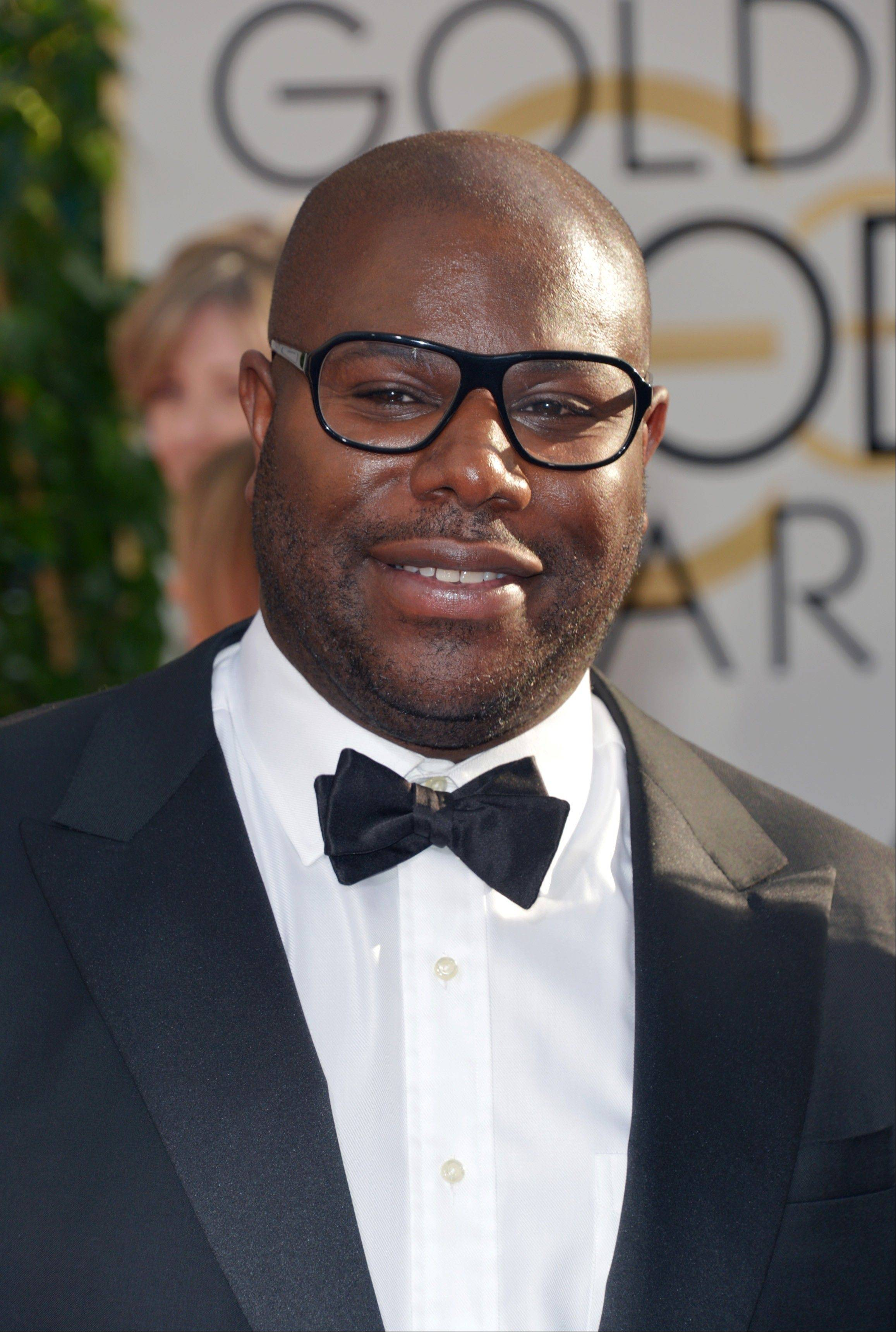 """12 Years a Slave"" director Steve McQueen arrives at the 71st annual Golden Globe Awards."