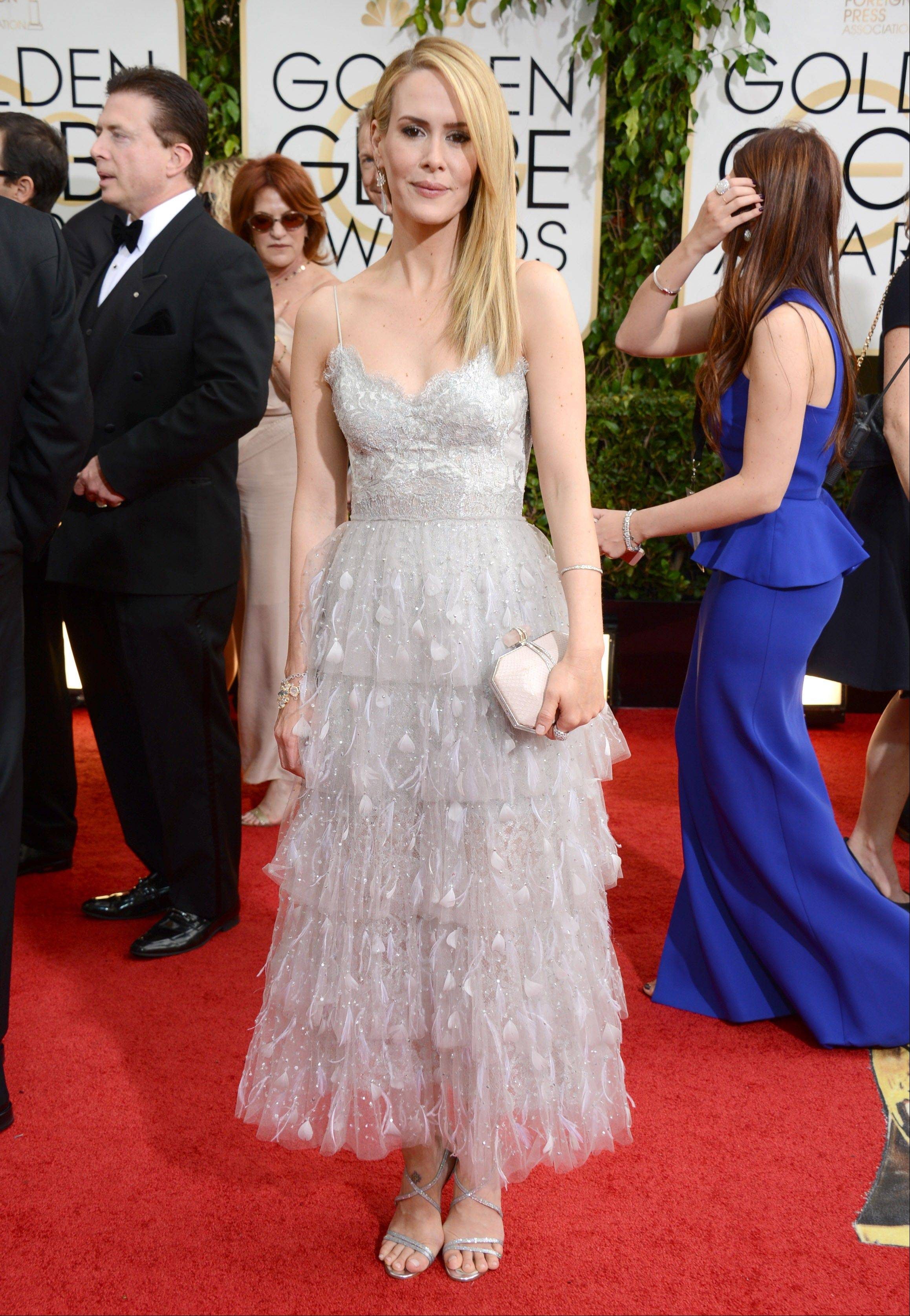 """American Horror Story"" star Sarah Paulson arrives at the 71st annual Golden Globe Awards."